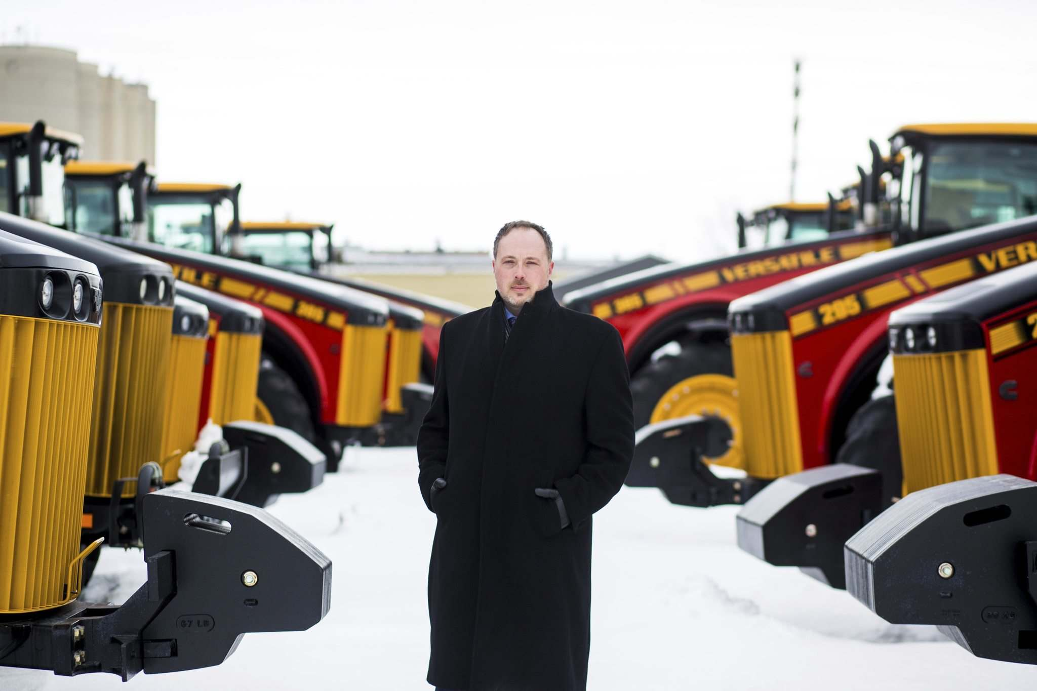 <p>Buhler vice-president of sales and marketing Adam Reid, seen with Versatile tractors on Monday, says the company does not expect it will need to increase staff in the short term in the wake of its partnership with Japan's Kubota Corp.</p>