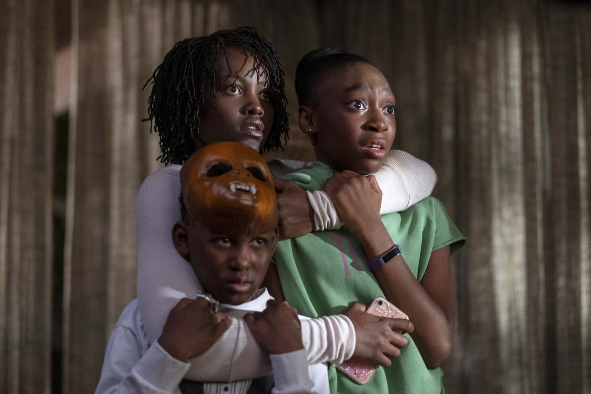 Evan Alex (from left), Lupita Nyong&rsquo;o and Shahadi Wright Joseph in a scene from Us. (Claudette Barius / Universal Pictures) </p>