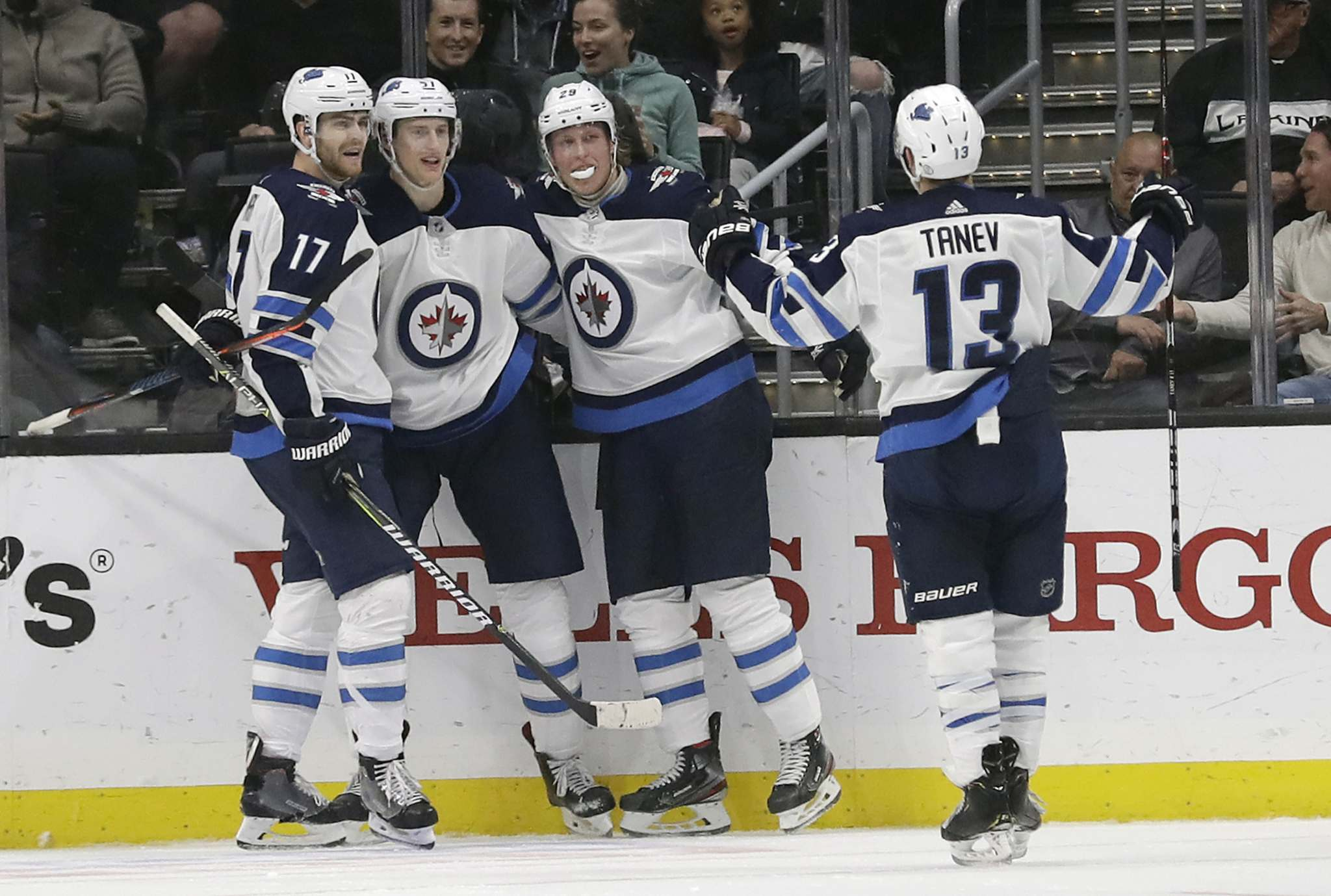 Myers, second from left, celebrates his goal with teammates Adam Lowry, left, Patrik Laine, centre, and Brandon Tanev during the game against the Los Angeles Kings Monday. (Jose Sanchez / The Associated Press)