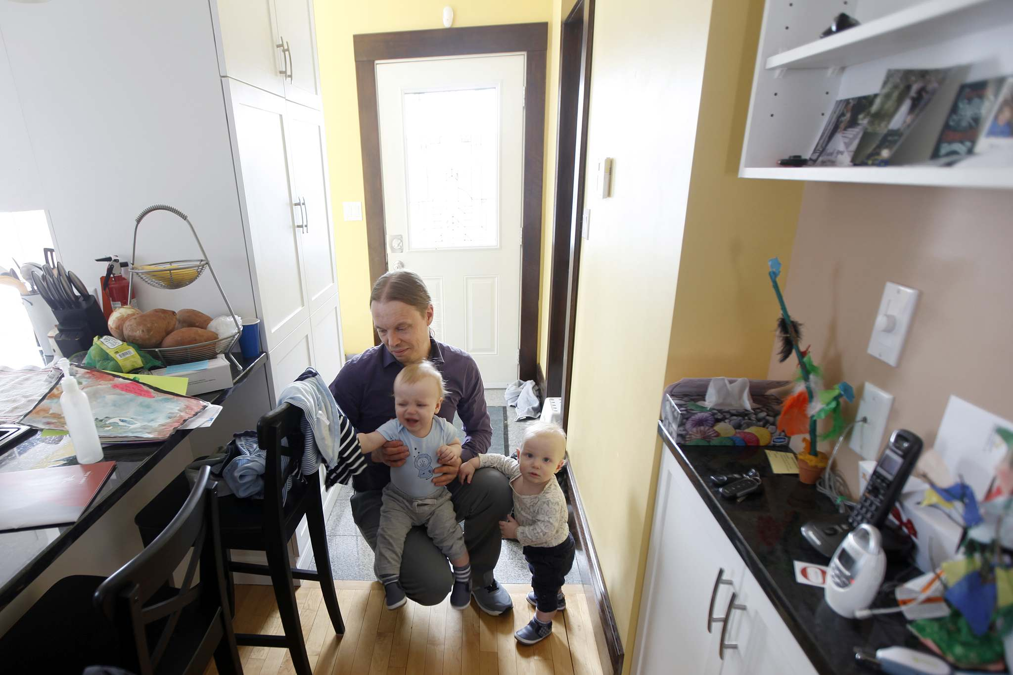 PHIL HOSSACK / WINNIPEG FREE PRESS</p><p>Travis Tomchuk and his twin sons Émile (in blue) and Anton at home; stay-at-home dads are increasingly prevalent in Canada.</p>