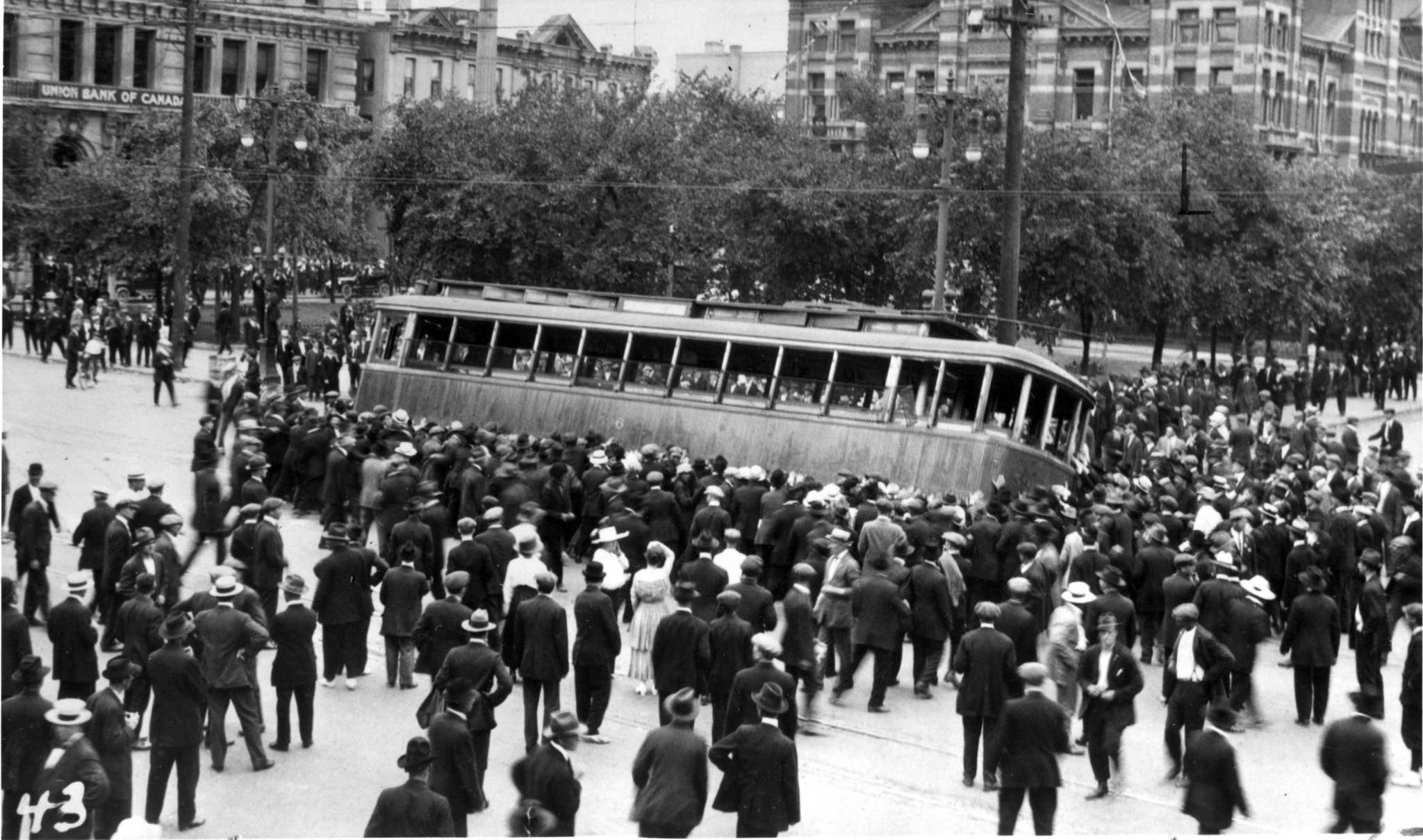 In one of the most iconic images from the strike, a streetcar is overturned on Main Street in front of the old city hall building. (Winnipeg Free Press files)</p>