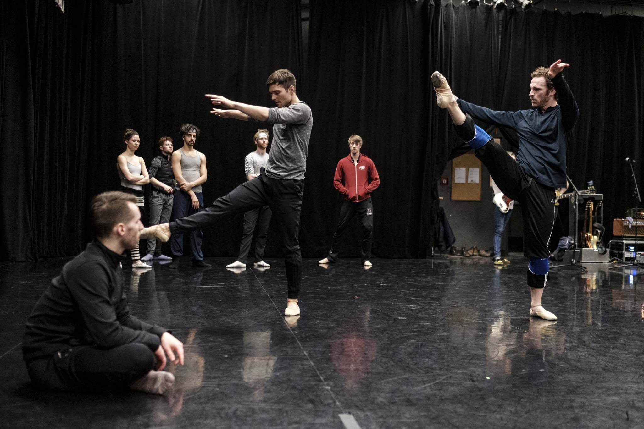 Choreographer Philippe Larouche (left) watches as Ryan Vetter (centre) and Liam Caines practise at an open rehearsal for Ballet And The Band. (Daniel Crump / Winnipeg Free Press)