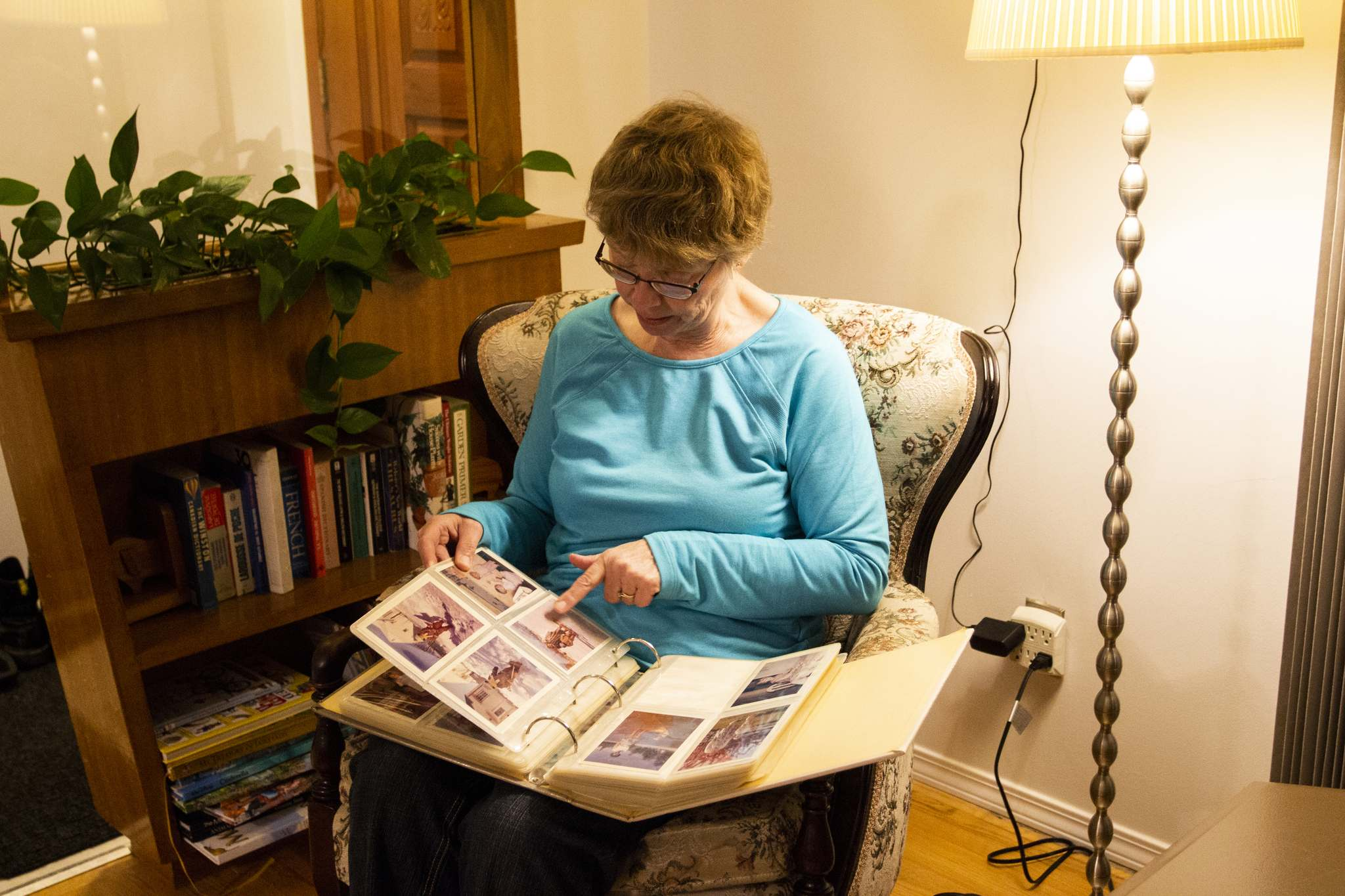 Dorothy Stephens looks through an album with photos of her mother, who died from complications of Alzheimer's disease in 2014.