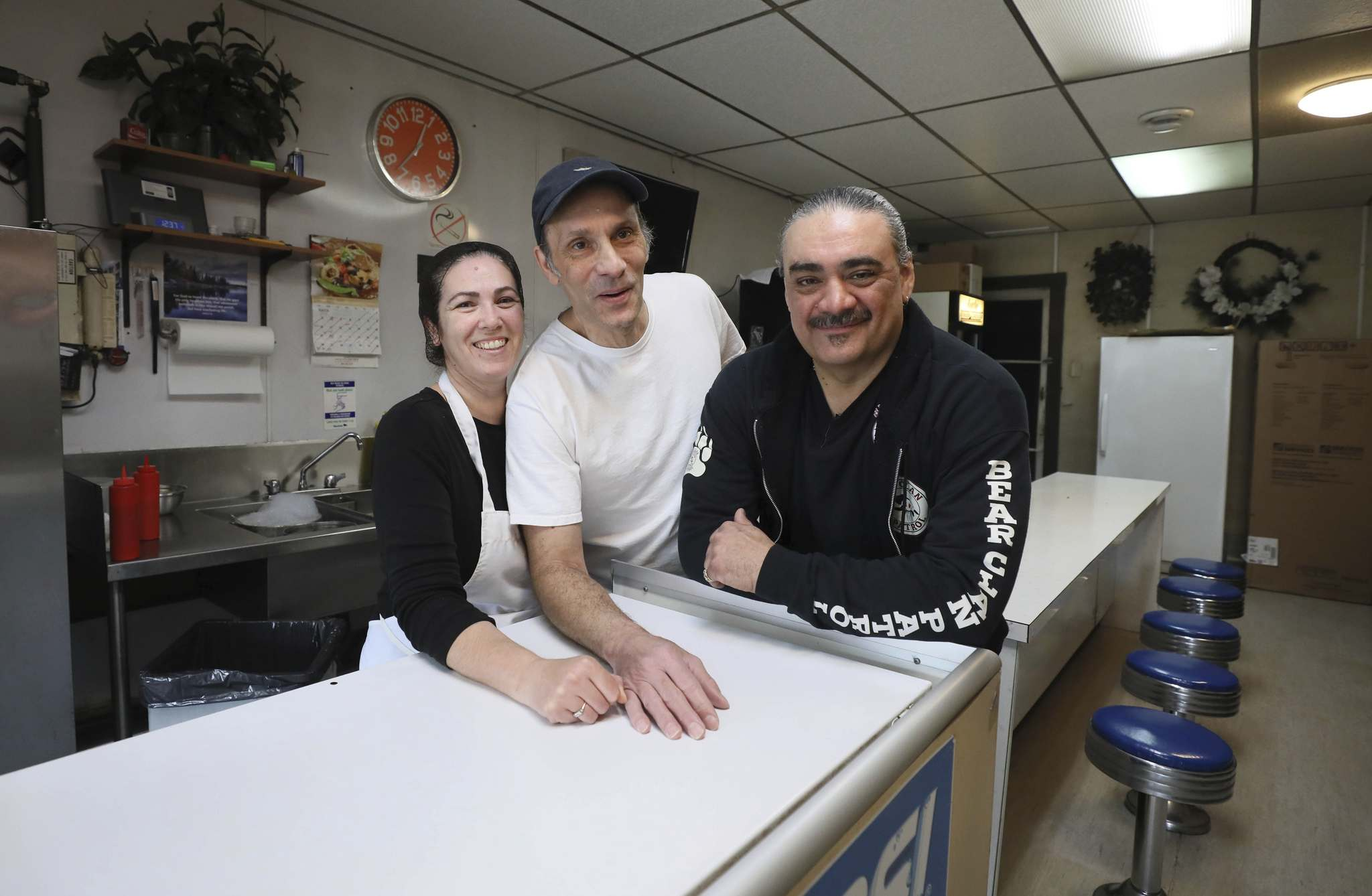 RUTH BONNEVILLE / WINNIPEG FREE PRESS</p><p>Susan (left) and Angelo Tiginagas with Favel at his favourite eatery, Angelo's Chip Shop, on Main Street.</p>