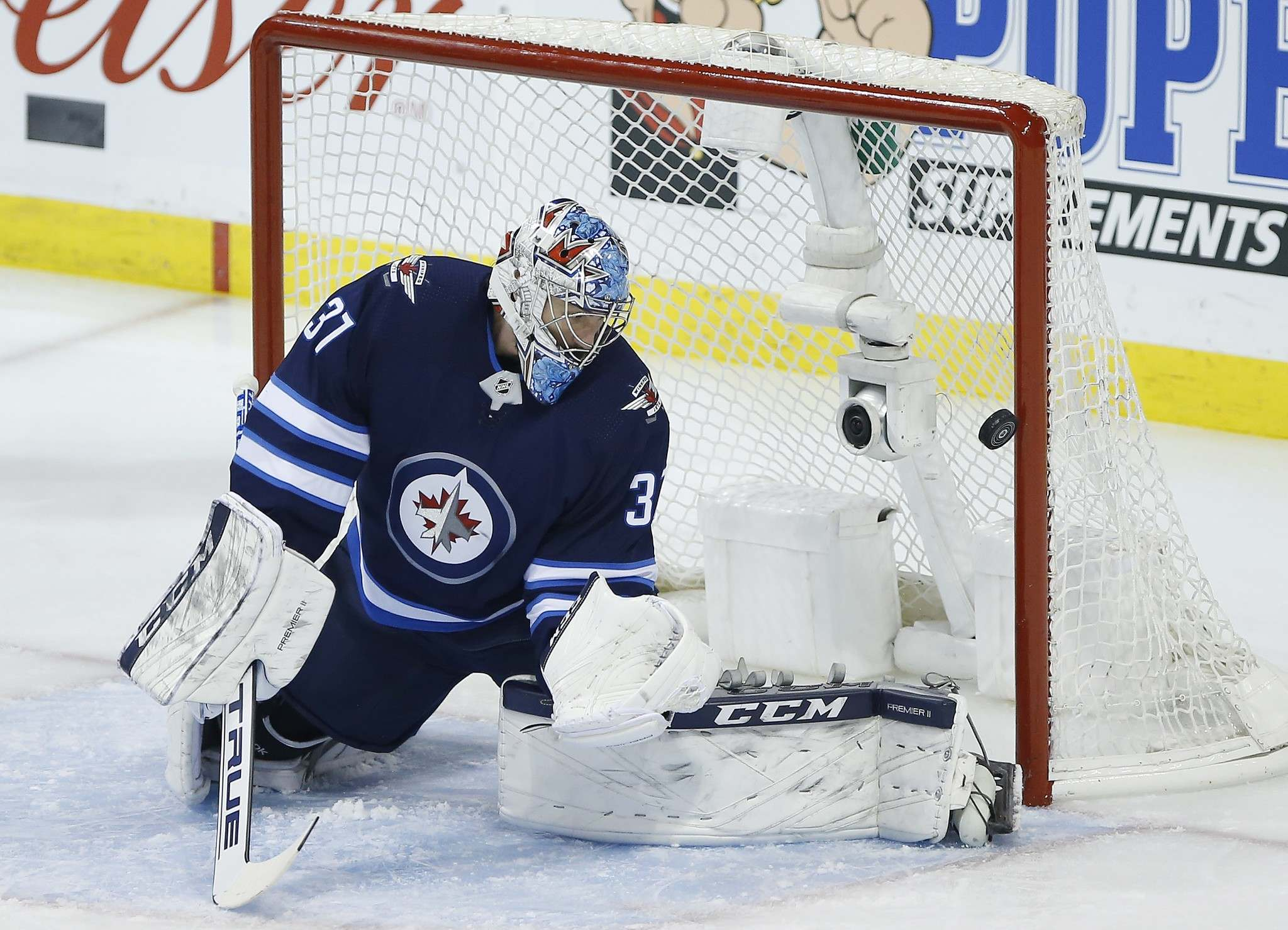 """John Woods</p> <p>/ The Canadian Press</p> <p>Winnipeg Jets goaltender Connor Hellebuyck (37) watches as a Montreal Canadiens' shot goes off the post during first period NHL action in Winnipeg on Saturday, March 28, 2019.</p> <p>""""></a><figcaption readability="""