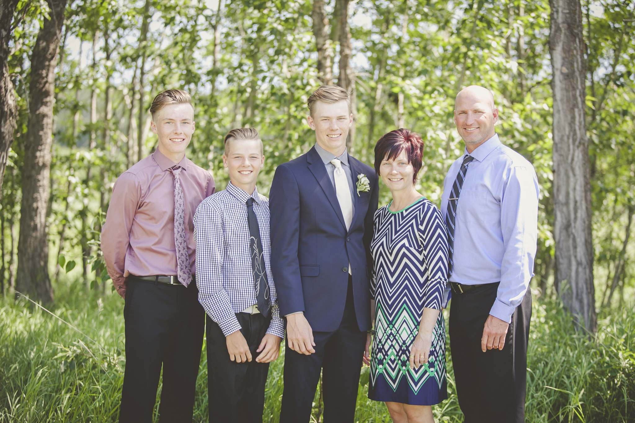 Former Brandon Wheat Kings defenceman Craig Geekie, right, and wife Tobi are shown with sons, left to right, Noah, Conor and Morgan at the latter's graduation two years ago. (Submitted)</p>