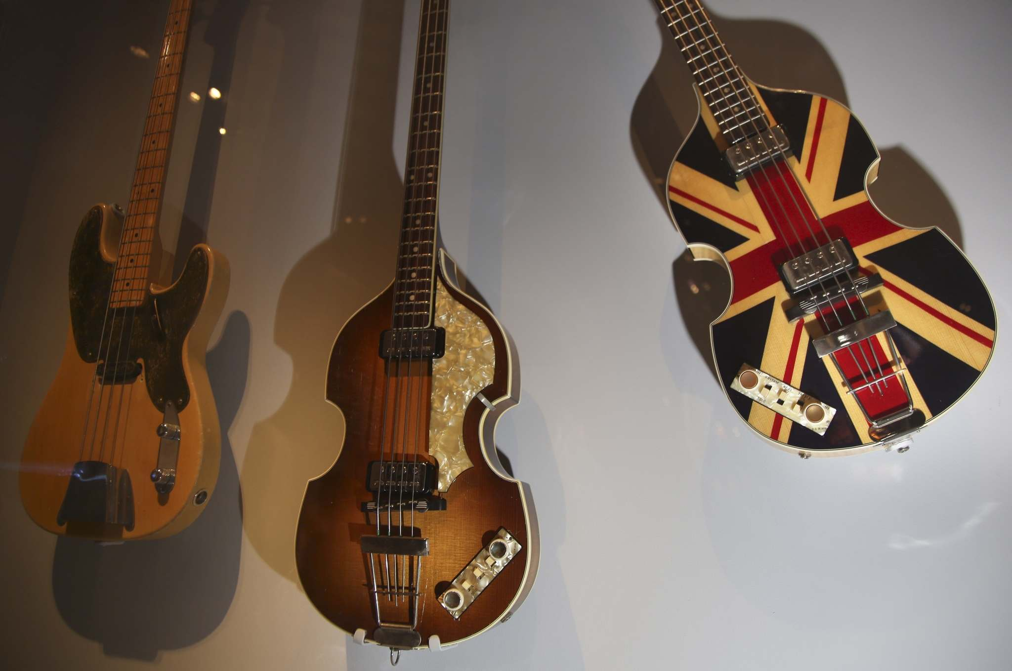 "Guitars, including a bass, right, designed for Paul McCartney on the occasion of Queen Elizabeth's Diamond Jubilee celebration, are displayed at the exhibit ""Play It Loud: Instruments of Rock & Roll,"" at the Metropolitan Museum of Art in New York, Monday, April 1, 2019. The exhibit, which showcases the instruments of rock and roll legends, opens to the public on April 8 and runs until Oct. 1, 2019. (AP Photo/Seth Wenig)</p>"