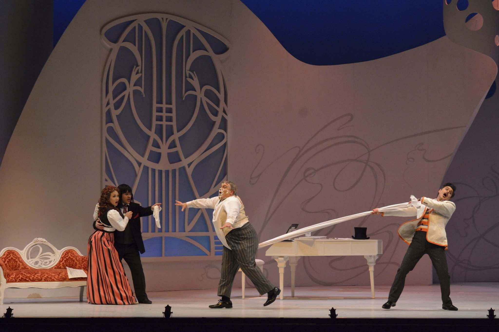 Figaro, played by Elliot Madore (right), comes to the rescue of Rosina, played by Andrea Hill, and Count Almaviva, played by Andrew Owens. Rosina and the count were caught in their tryst by Dr. Bartolo, played by Steven Cody. (Robert Tinker photo)