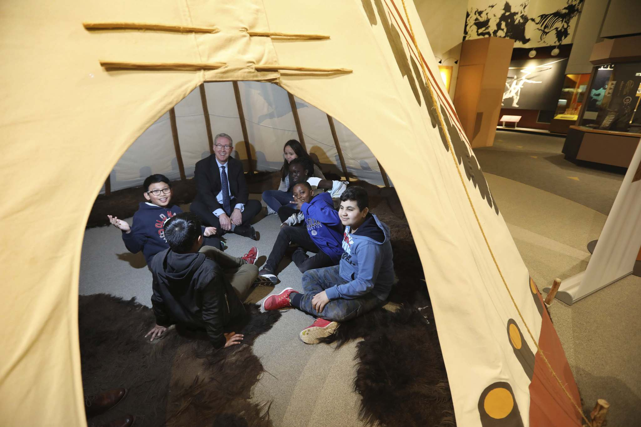 RUTH BONNEVILLE / WINNIPEG FREE PRESS</p><p>Canada Life CEO Paul Mahon chats with Grade 5 and 6 students from Victoria Albert School Wednesday in a teepee at the Manitoba Museum.</p>