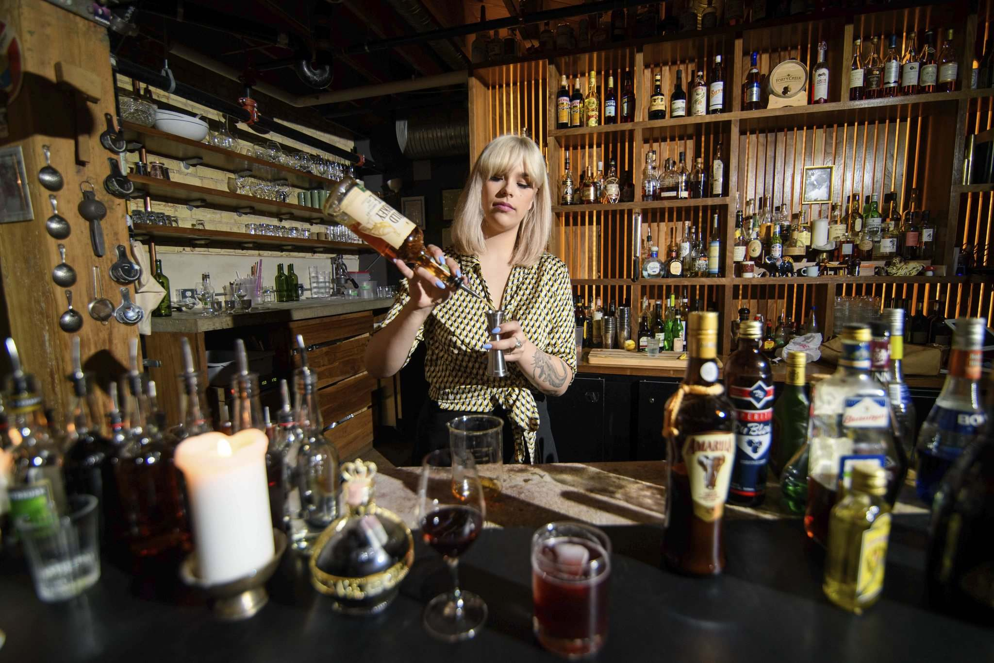 Mike Sudoma / Winnipeg Free Press</p><p>Bartender Nicole Cote works on a cocktail featuring leftover liqueurs and spirits from Free Press writers.</p>