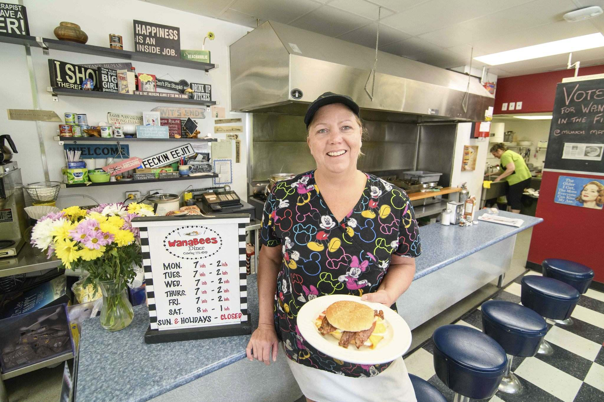 Mike Sudoma / Winnipeg Free Press</p><p>WanaBees owner and Munch Madness runner-up Karen Ashley with her classic breakfast bunwich.</p>