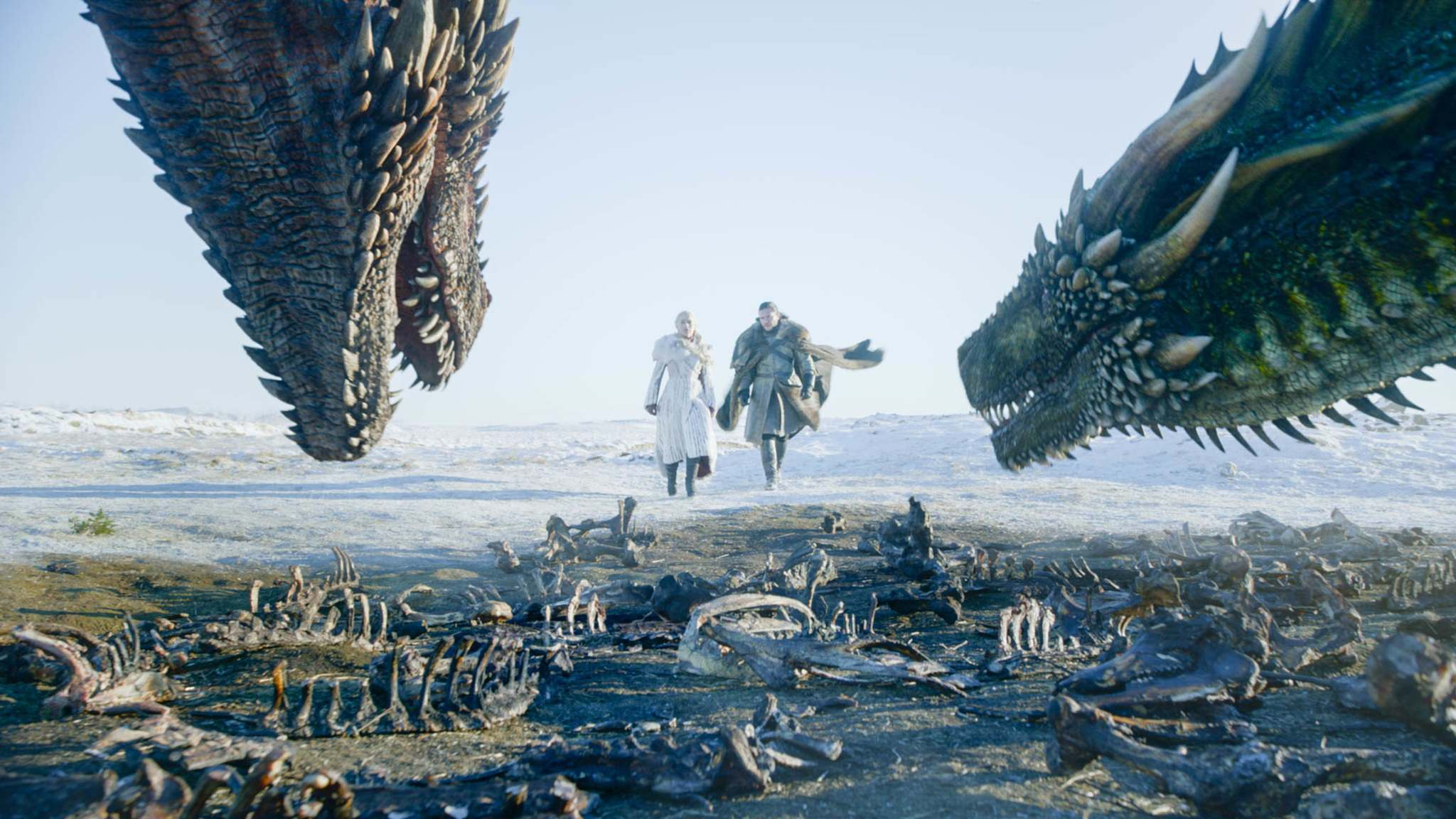 Daenerys (Emilia Clarke) and Jon Snow check on her two dragons. (HBO)