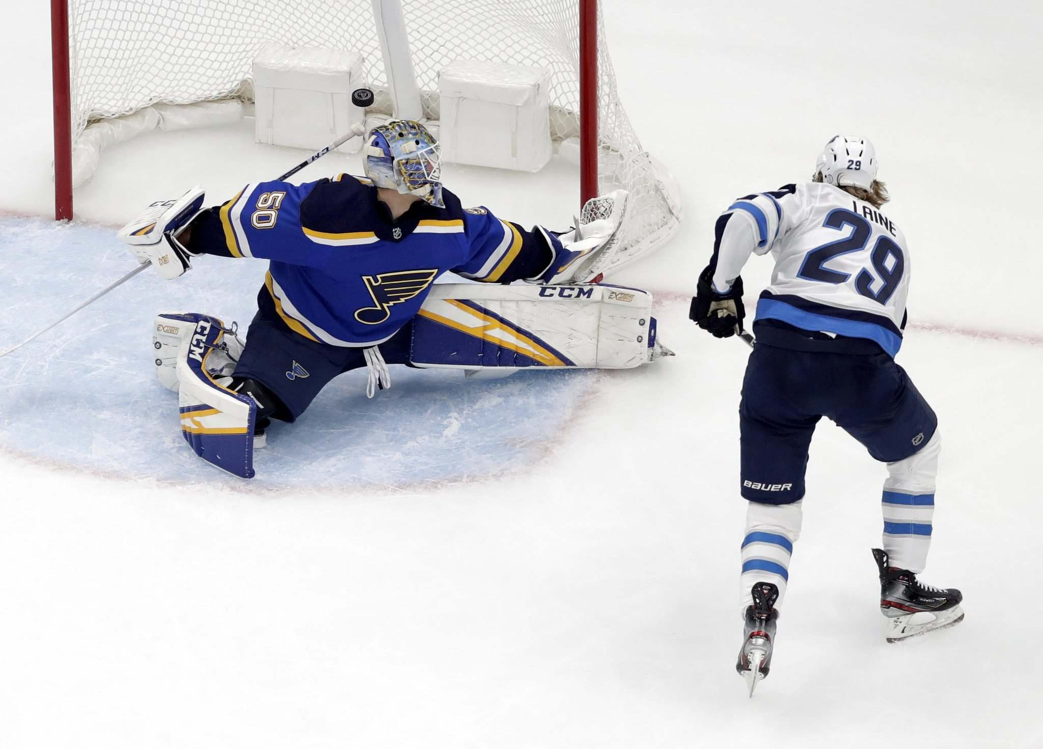 <p>Patrik Laine puts the puck past Blues goaltender Jordan Binnington in Game 3 Sunday. The Jets would score 6 goals on the seemingly unbeatable goalie for a 6-3 win over the Blues, the Jets first in the series.</p>