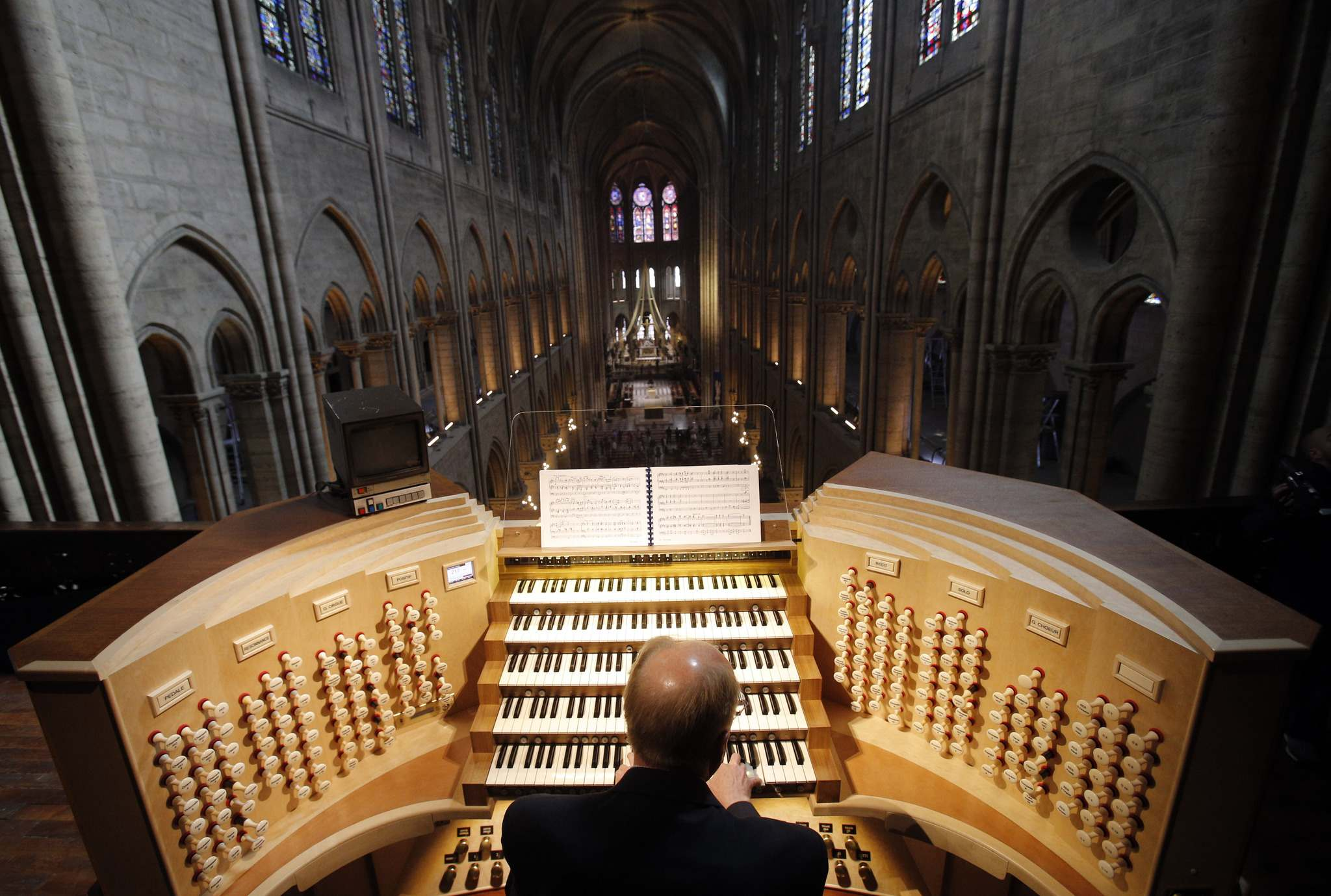 Christophe Ena / The Associated Press files</p><p>Philippe Lefebvre plays the organ at Notre Dame Cathedral in Paris. </p>