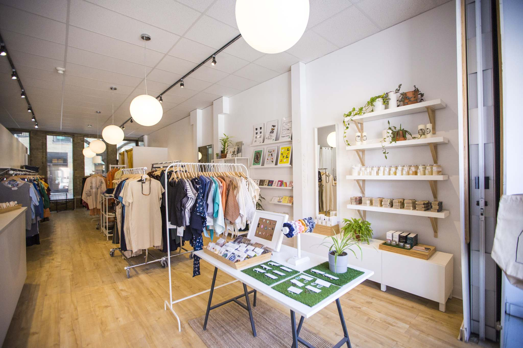 MIKAELA MACKENZIE / WINNIPEG FREE PRESS</p><p>Clothing at Shop Take Care is organized by colour, instead of gender or size.
