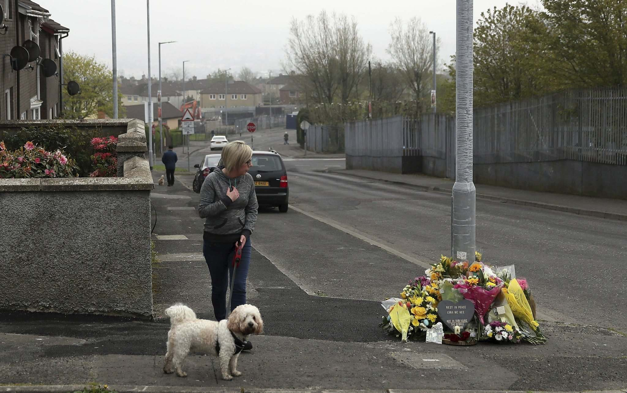 Brian Lawless / PA / The Associated Press Files</p><p>A woman stops to pay her respects at the scene where 29-year old journalist Lyra McKee was fatally shot while covering riots in Londonderry, Northern Ireland, on April 18.</p>