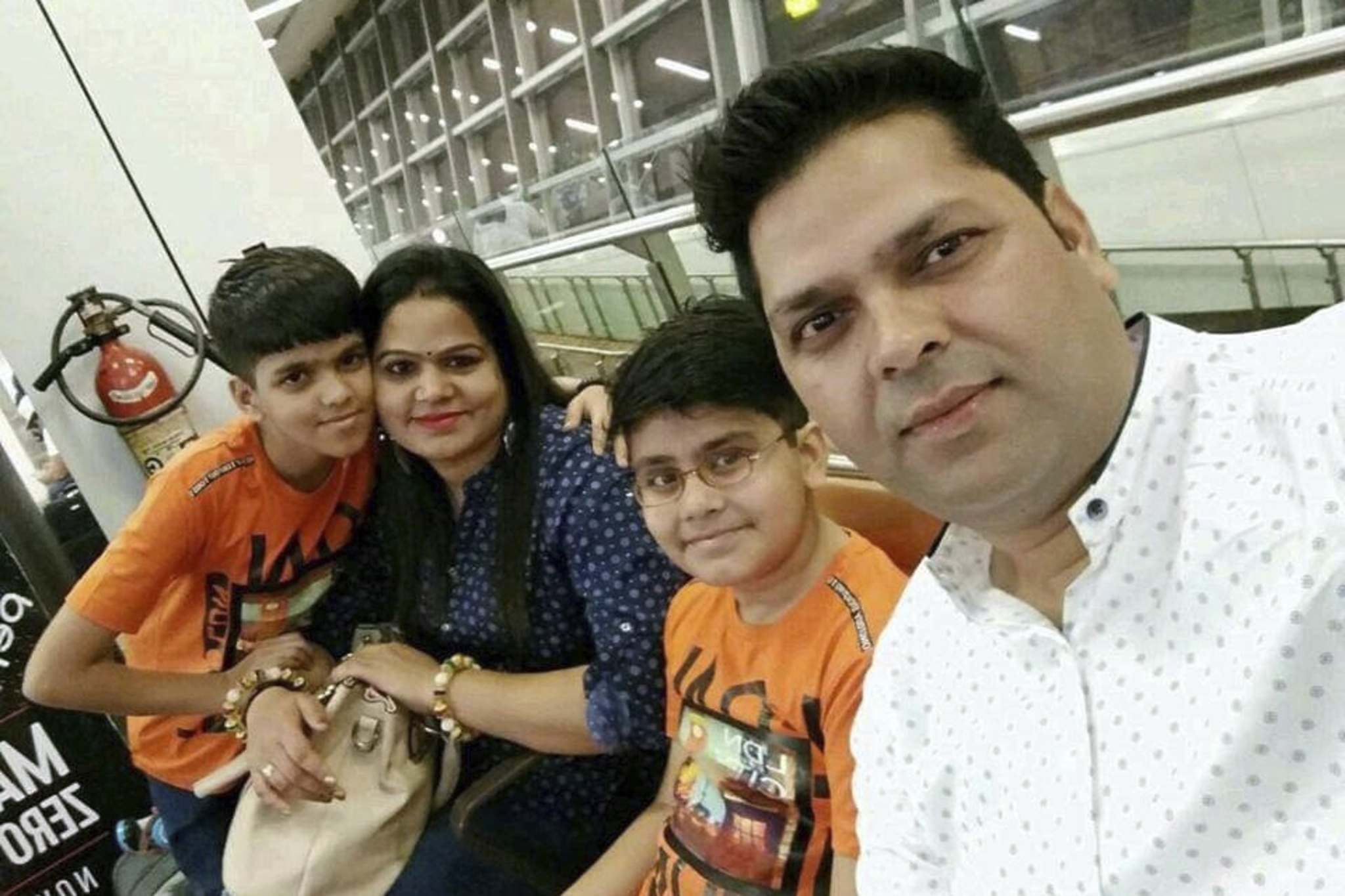 Ram Nivash Misra and Anupam Tripathi with their sons Shreyaan and Aaram. (GoFundMe)