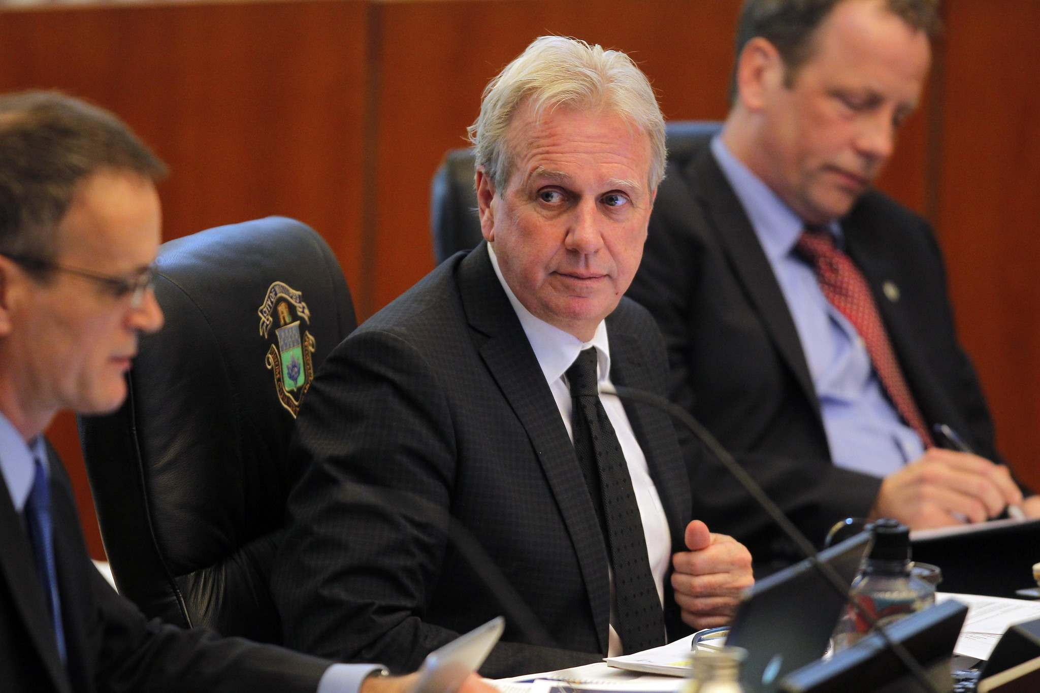 Planning, property and development department director John Kiernan (centre) says his investigation team isn't satisfied with some of the answers provided by city staff. (Boris Minkevich / Winnipeg Free Press files)</p>