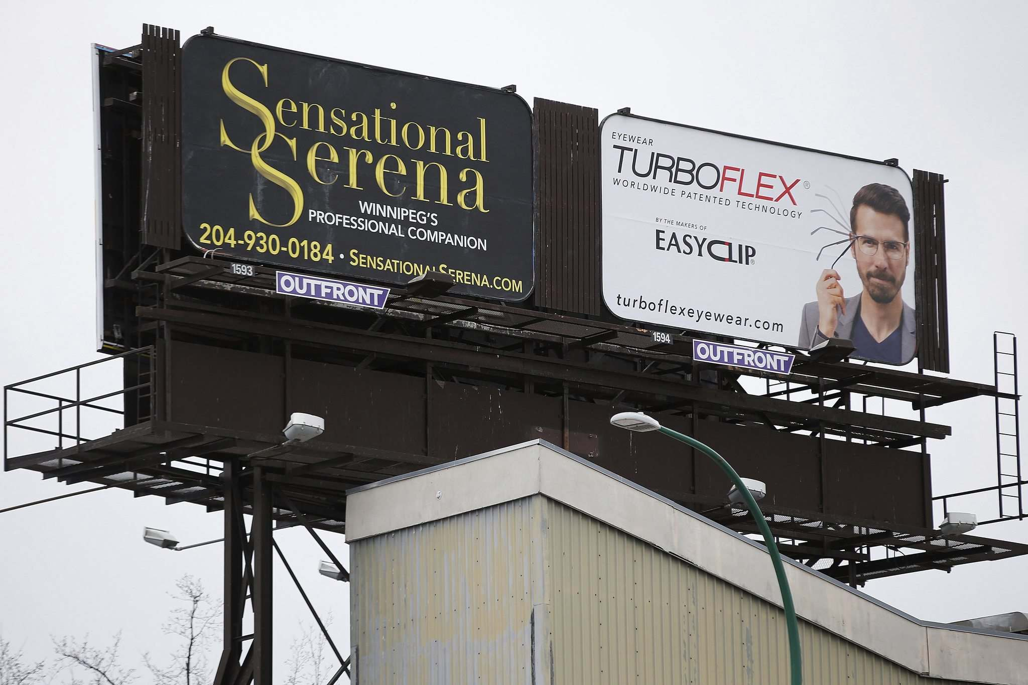 "JOHN WOODS / WINNIPEG FREE PRESS</p><p>A billboard advertising ""Winnipeg's Professional Companion"" has raised eyebrows among motorists on Portage Avenue.</p>"