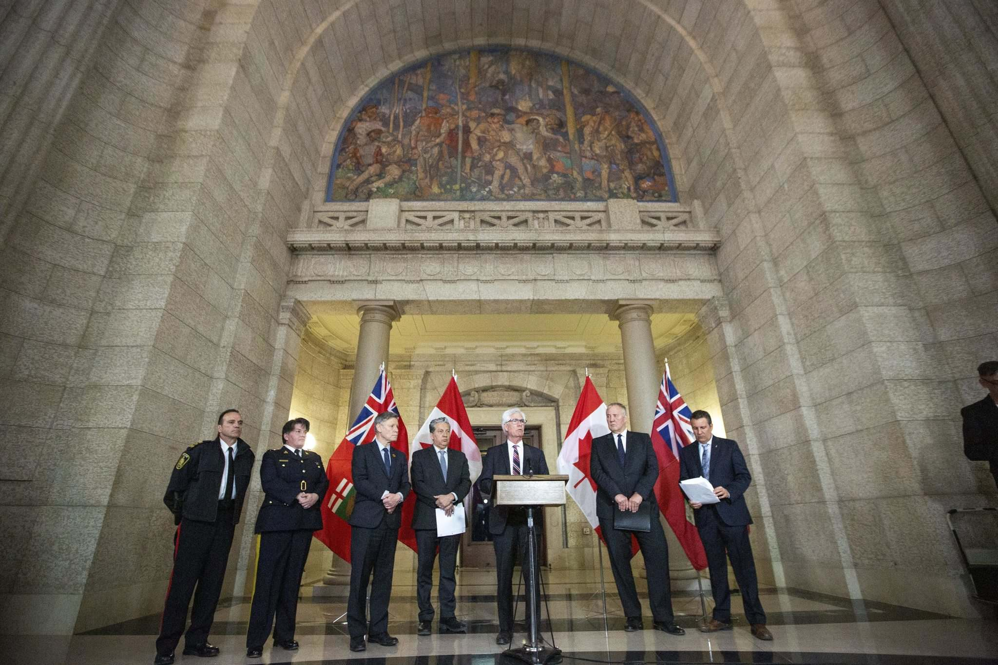 MIKAELA MACKENZIE/WINNIPEG FREE PRESS Minister of International Trade Diversification Jim Carr announces funding for gun and gang violence prevention along with Winnipeg police Chief Danny Smyth (from left), Assistant Commissioner Jane MacLatchy, MP Terry Duguid, MP Dan Vandal, Minister of Border Security and Organized Crime Reduction Bill Blair, and Minister of Justice Cliff Cullen at the Manitoba Legislative Building in Winnipeg on Friday. </p>