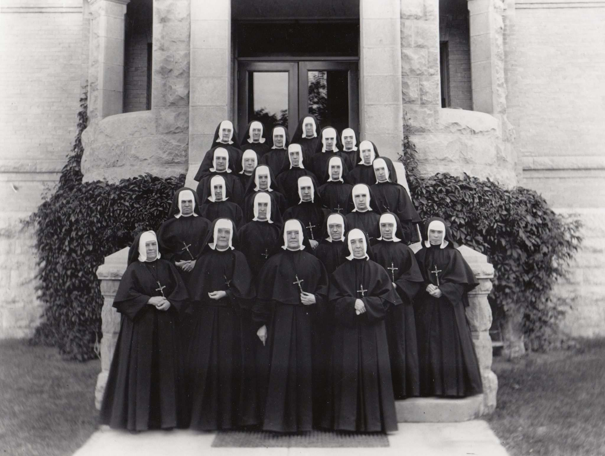 SUPPLIED  Sisters of the Holy Names of Jesus and Mary on the front steps of St Mary's Academy in 1915.
