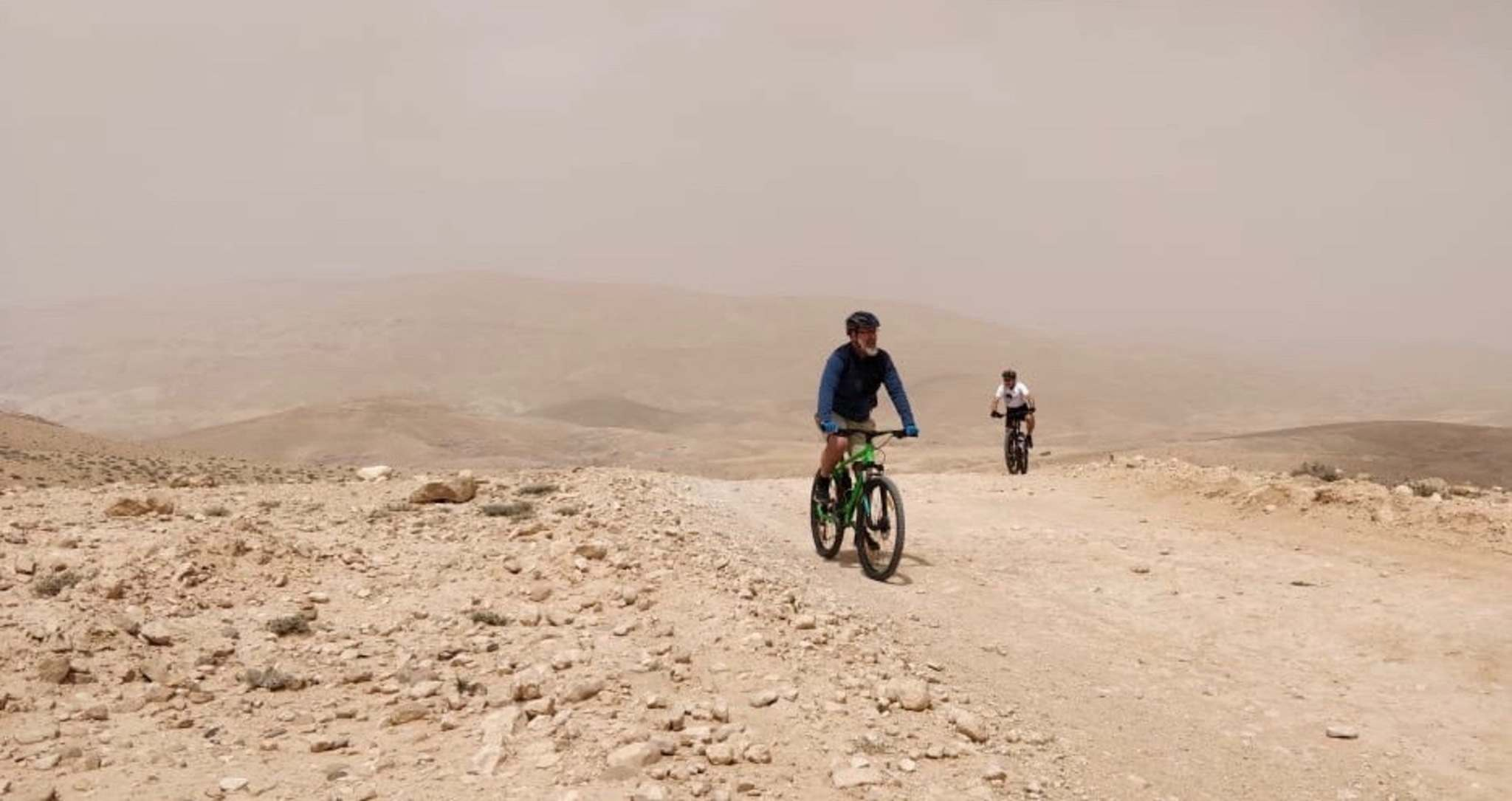 Lyons biking in the Jordanian desert. (Mark Edward Harris photo)