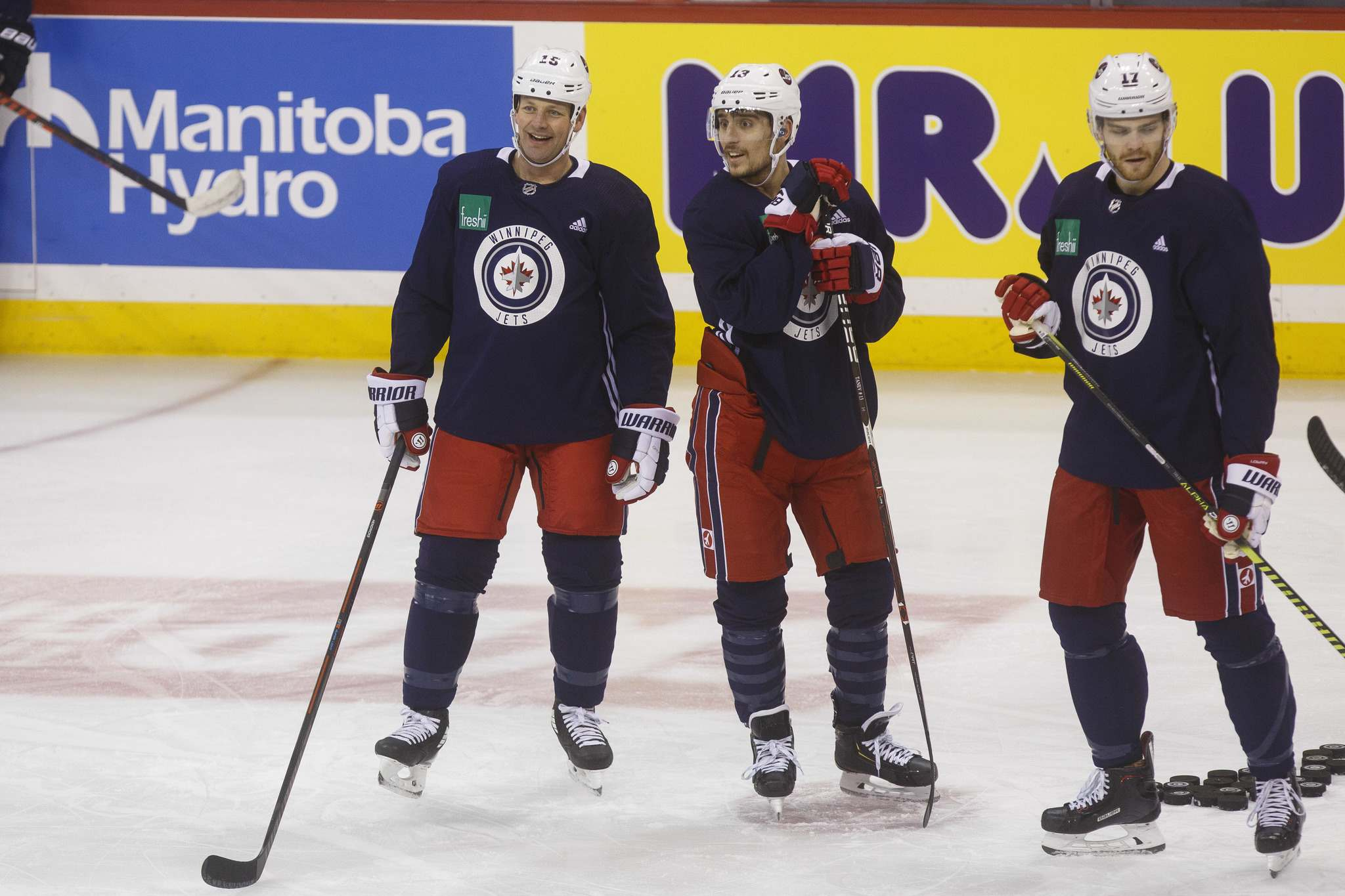From left: Matt Hendricks, Brandon Tanev and Adam Lowry during a pre-game skate in February at Bell MTS Place. (Mike Deal / Free Press files)