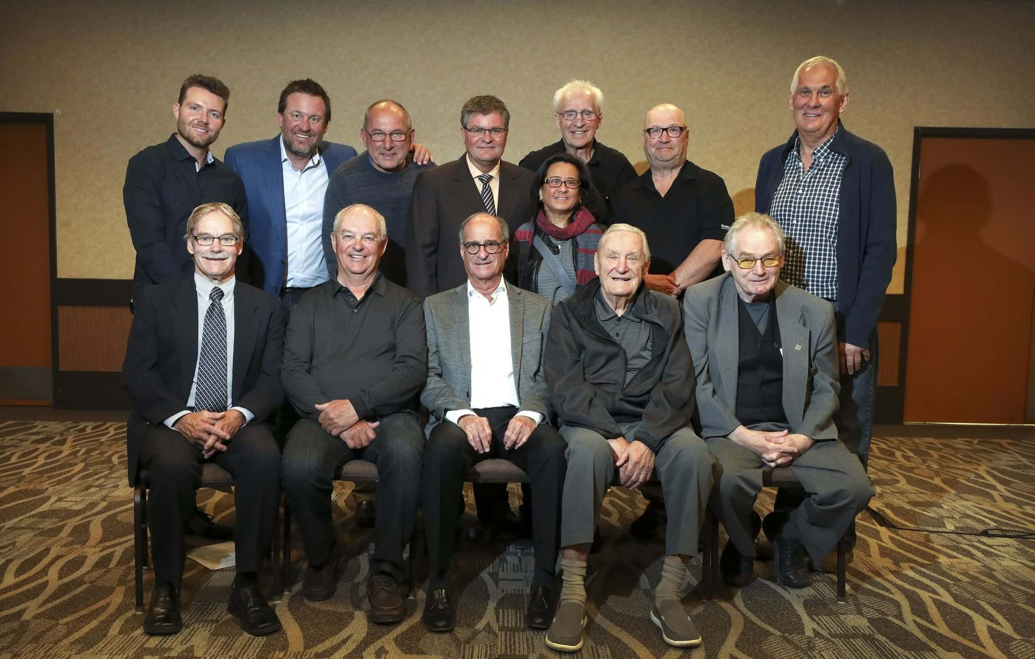 The Manitoba Hockey Hall of Fame announced its 2019 induction class on Thursday. Announcement attendees included (back row, from left): Mick McCrimmon, son of Kelly McCrimmon (builder); Trevor Kidd (player); Larry Bolonchuk (player); Rob Haithwaite (official); Jack Turner (Flin Flon Warriors); Ian Murray, father of Marty Murray (player); Bob Fitchner (player). Middle: Susana Yuen (player). Front, from left: Rod Lindquist (St. Boniface Mohawks); Don Yake, father of Terry Yake (player); Barry Shenkarow (builder); Ken Saunders (St. Boniface Canadiens); and Bob (Doc) Holliday (media).