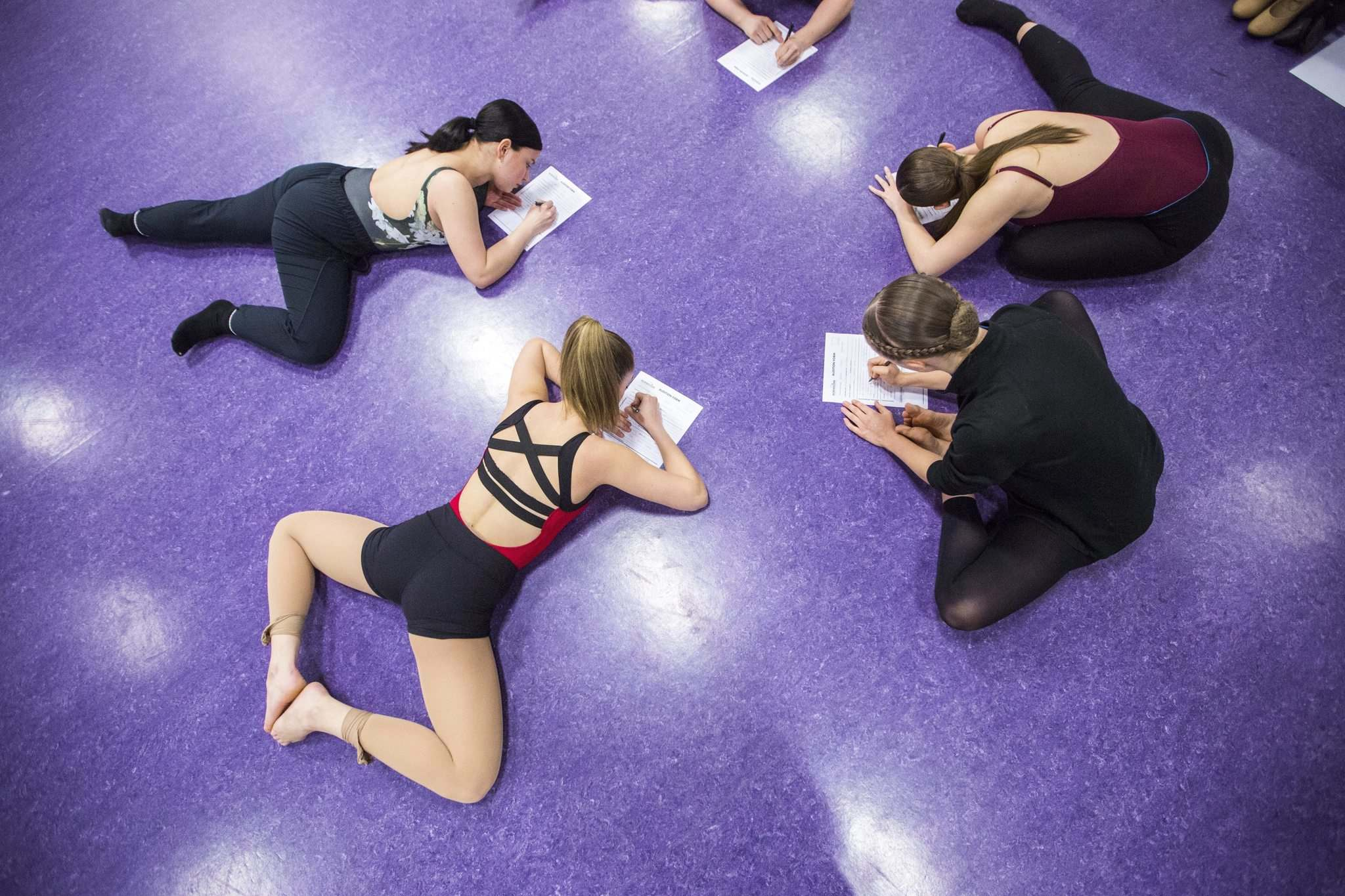 MIKAELA MACKENZIE / WINNIPEG FREE PRESS</p><p>Dancers Annika McCabe (left), Haley Myers, Karissa Bowden, and Shannon Ward fill out the forms for auditions with Norwegian Cruise Lines.</p>