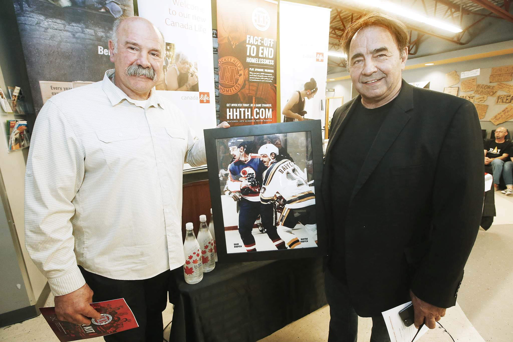 JOHN WOODS / WINNIPEG FREE PRESS</p><p>Former Winnipeg Jet Dave Babych, left, and his brother Wayne are ambassadors for Hockey Helps the Homeless.</p>