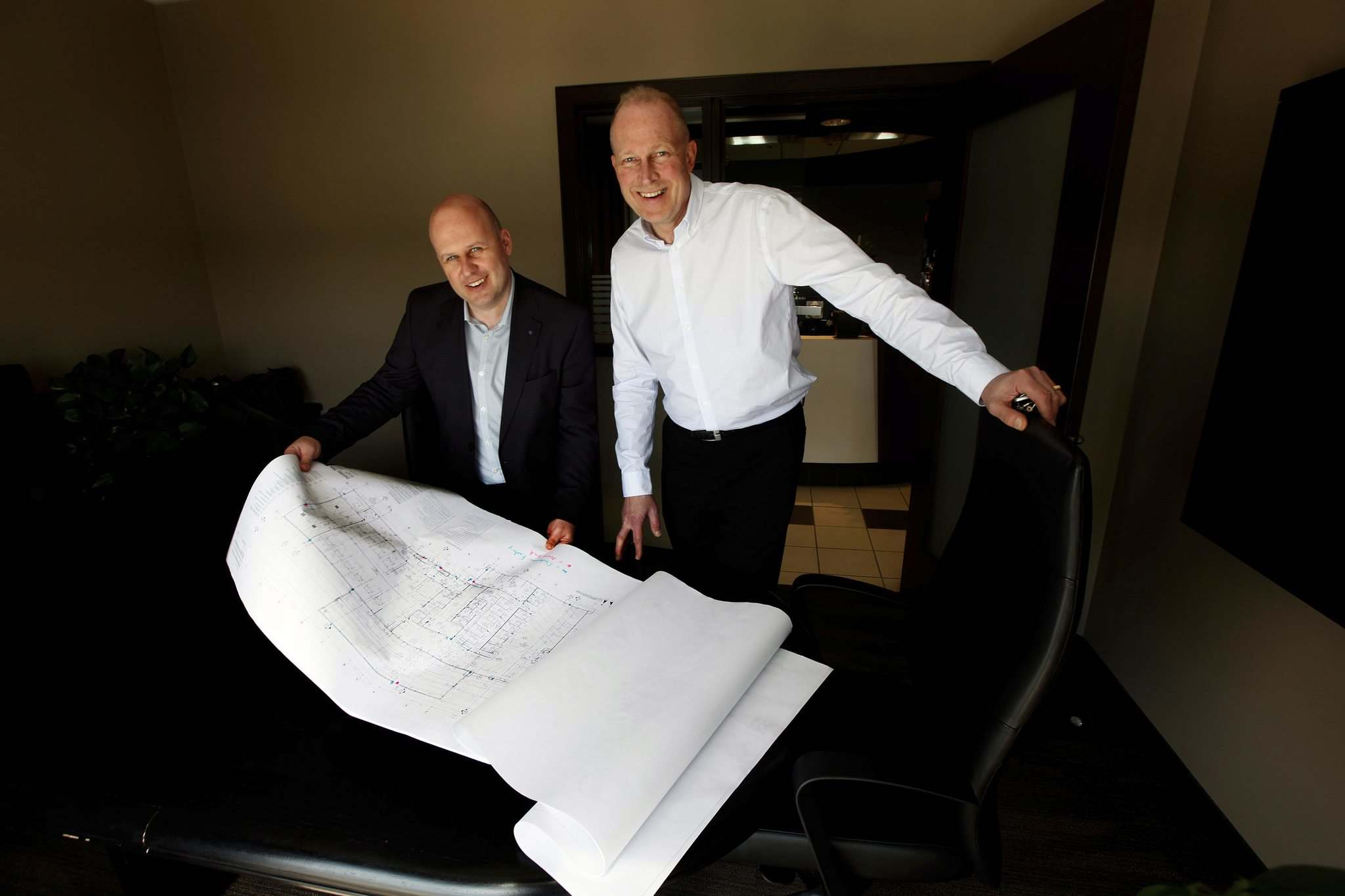 Birchwood Automotive Group's Kevin McNeill (left) and Rene Nicholson survey designs for expansion. (Phil Hossack / Winnipeg Free Press)</p>