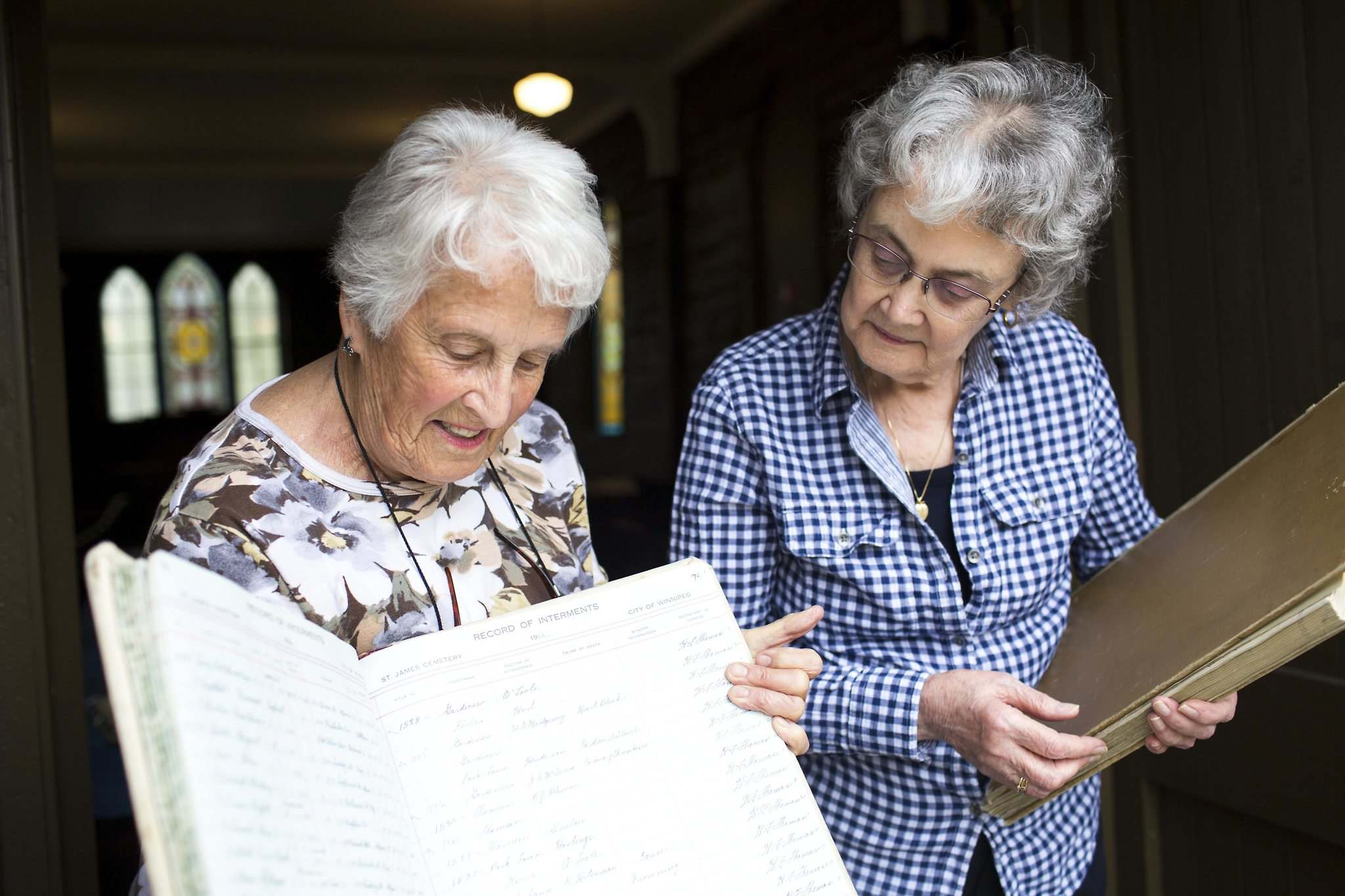 Margaret Steele (left) and Rosalie Gill found records in a missing register at St. James Anglican Church with information about over 2,800 miscarried or stillborn babies. (Mikaela MacKenzie photos / Winnipeg Free Press)