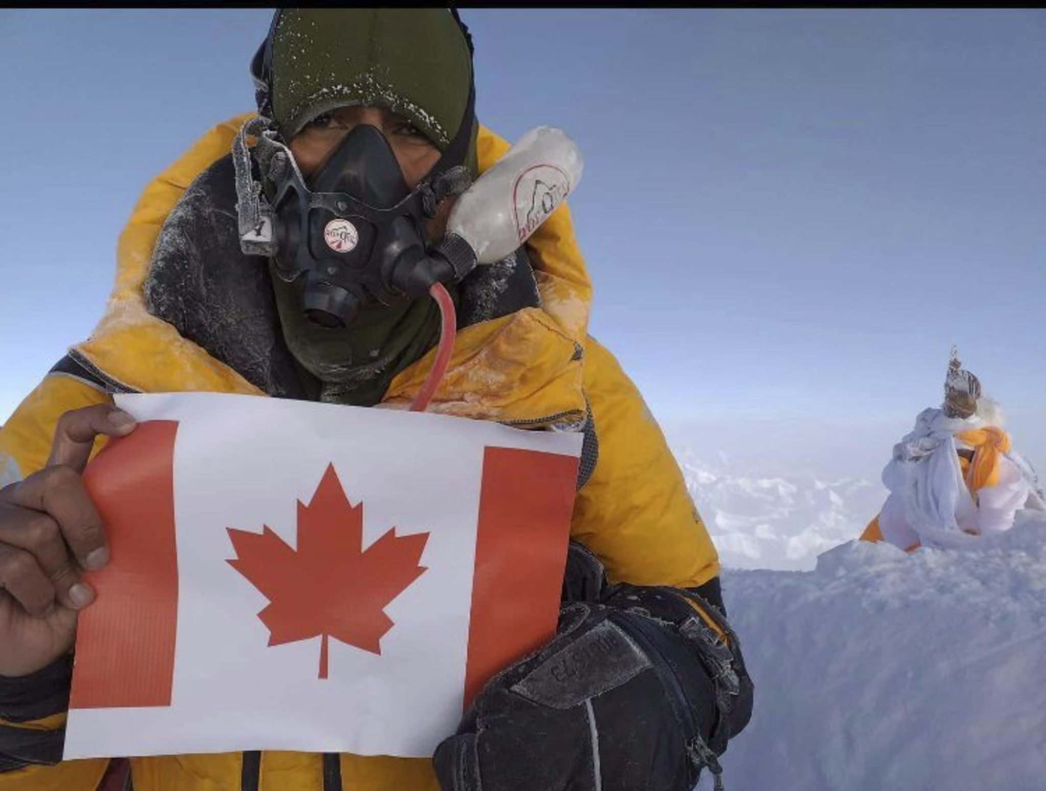 <p>Dalip Shekhawat at the summit of the world's highest mountain — Mount Everest