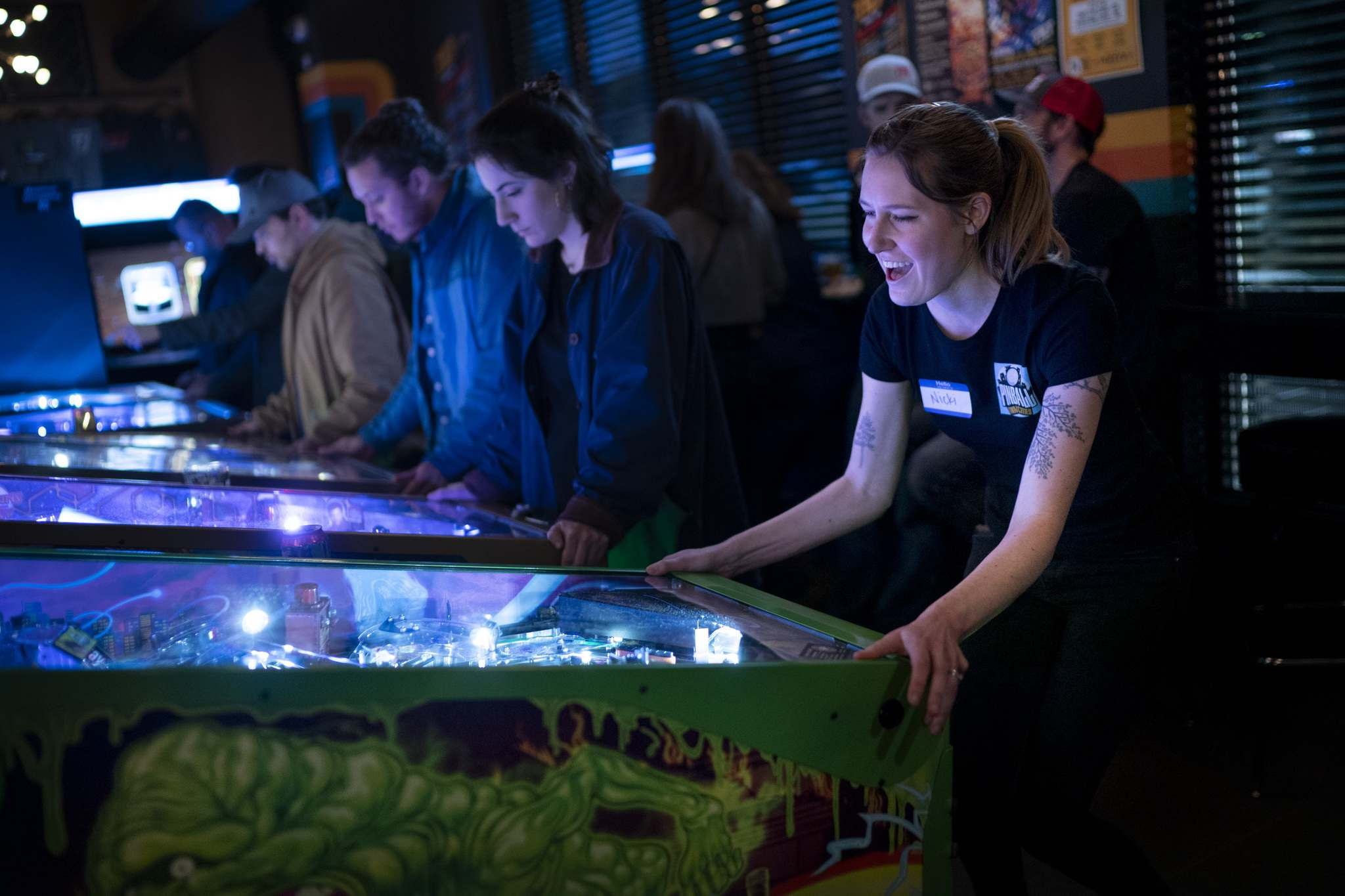 Renee Jones Schneider / Minneapolis Star Tribune</p><p>Nicki Eisenrich is happy to get a high score as she plays a Ghostbusters pinball machine during a women-only pinball tournament at TILT in Minneapolis.</p></p>
