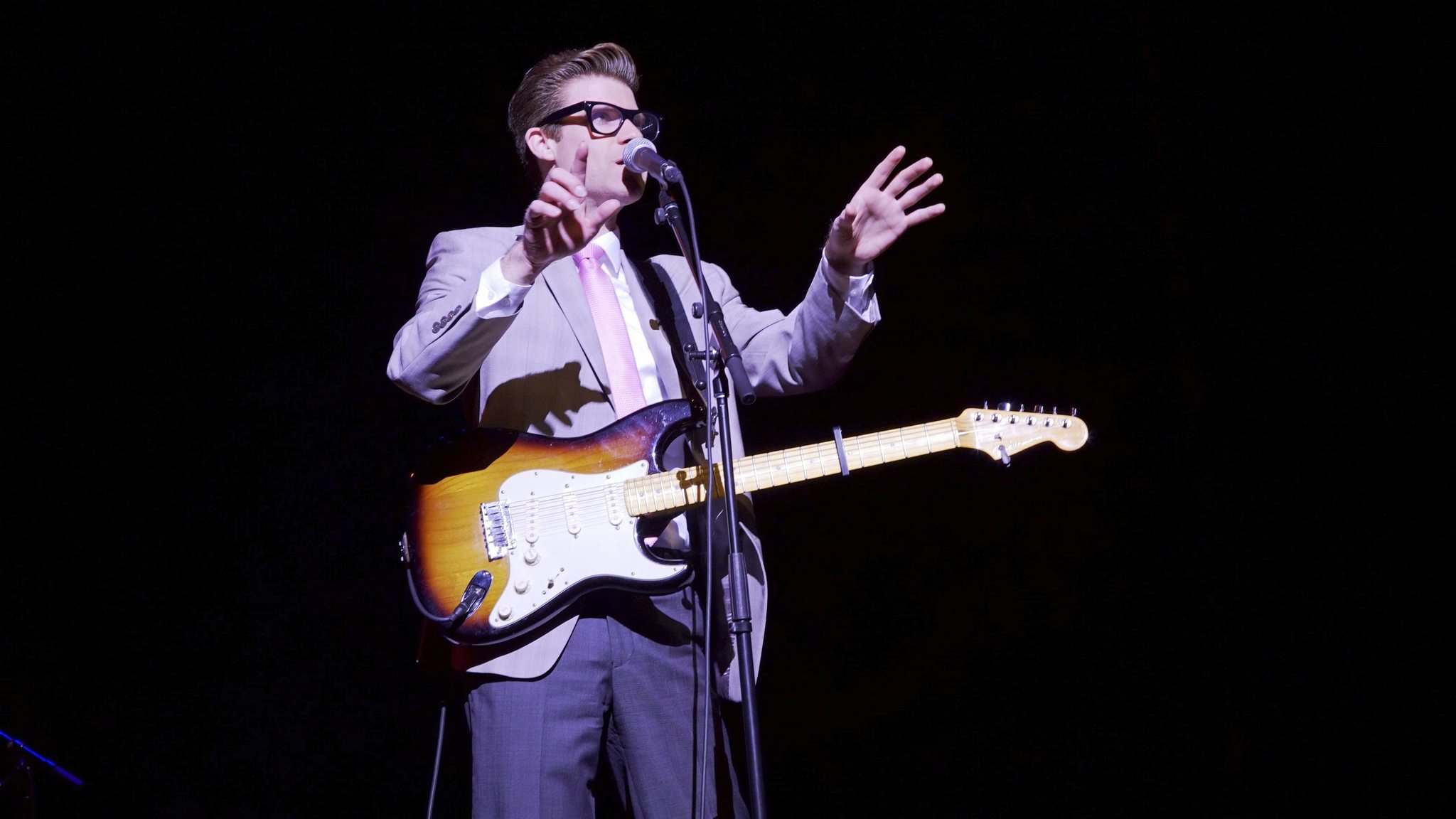 MERIT MOTION PICTURES</p><p>Jeff Giles dons the big black glasses to play Buddy Holly in Almost Almost Famous.</p>