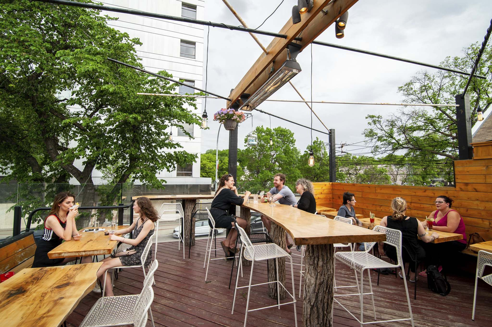 Patio goers take in the sweltering temperatures late last week on The Roost's rustic rooftop. (Mike Sudoma / Winnipeg Free Press)