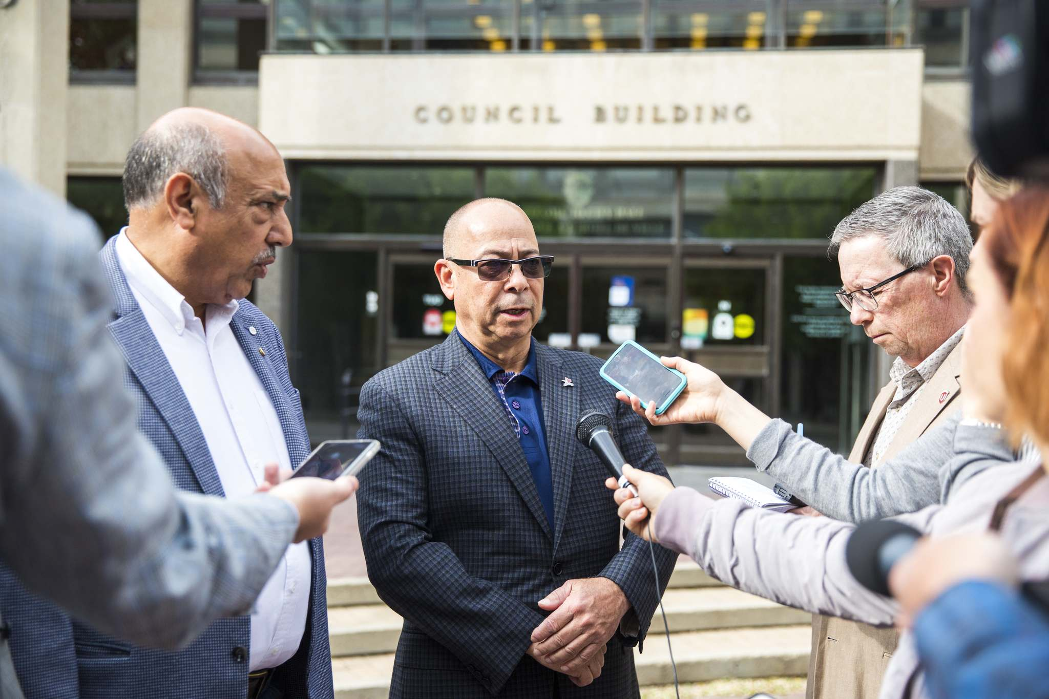 MIKAELA MACKENZIE / WINNIPEG FREE PRESS</p><p>John Costa, ATU International president, centre, speaks to the media with Aleem Chaudhary, left, ATU 1505 president, outside of City Hall in Winnipeg on Tuesday.</p>
