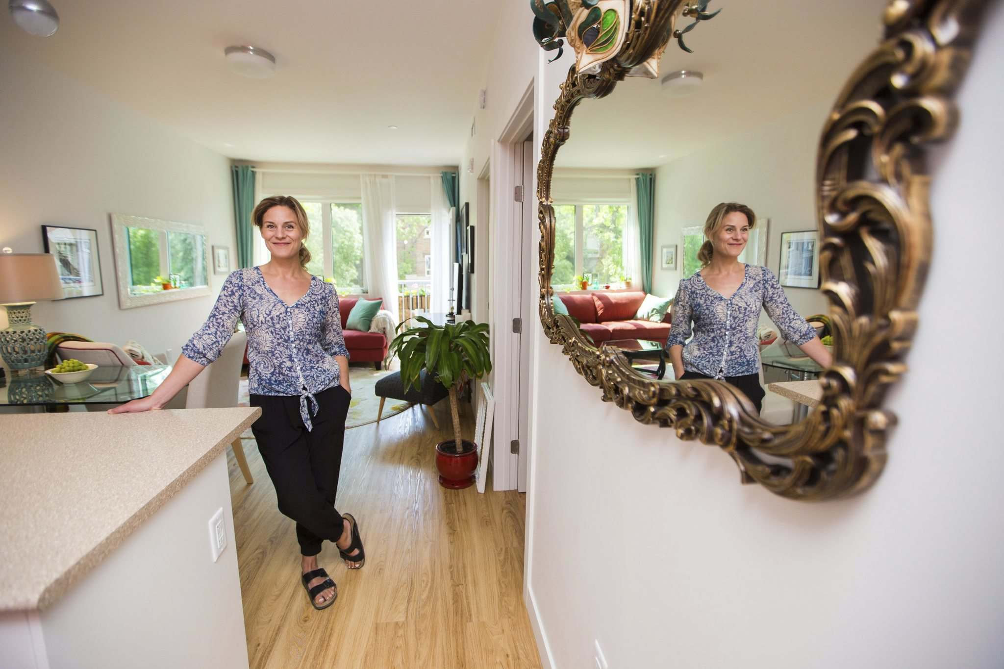 MIKAELA MACKENZIE / WINNIPEG FREE PRESS</p><p>Alicia Johnston showcases her suite at the Old Grace Housing Co-operative, where she moved from St. Norbert. She likes the sense of community and the focus of sustainability.</p>