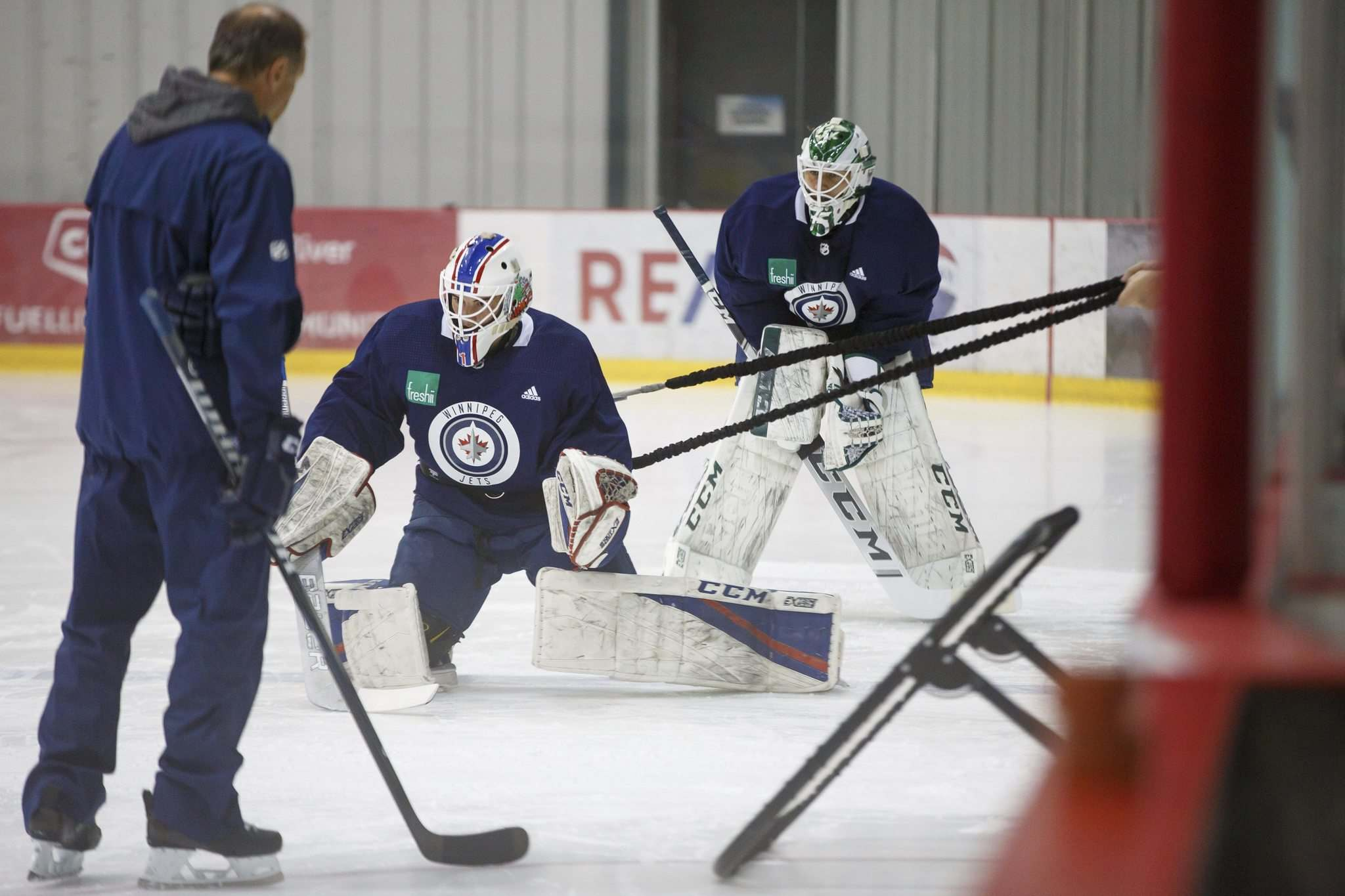 MIKE DEAL / WINNIPEG FREE PRESS</p><p>Winnipeg Jets goaltending prospect Arvid Holm (right) watches Logan Neaton work on a drill during development camp on Monday morning.</p>