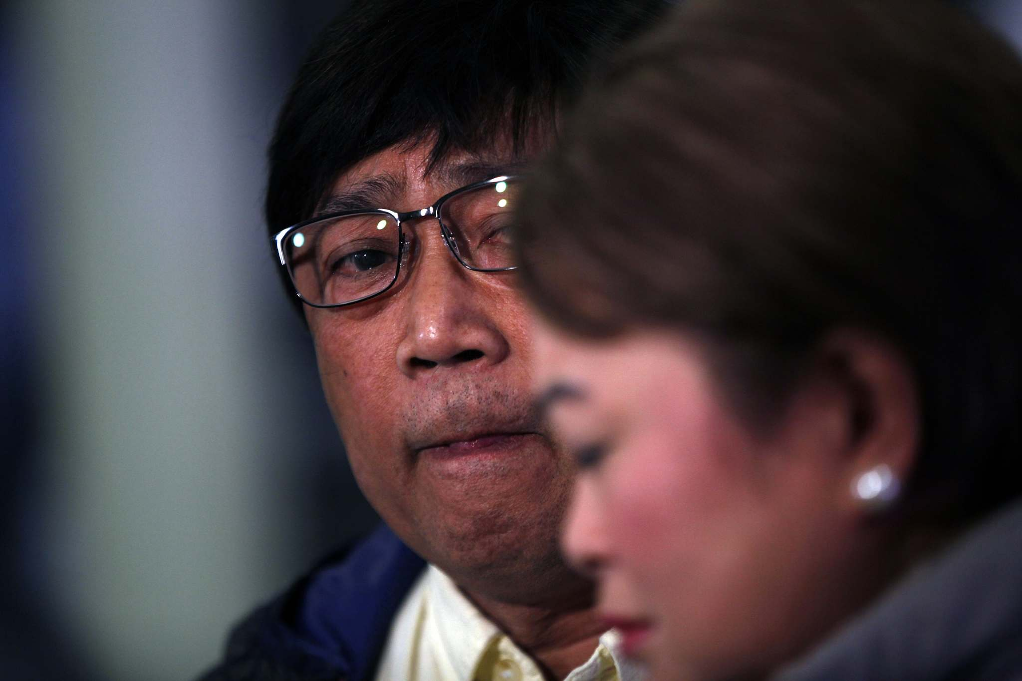 PHIL HOSSACK / WINNIPEG FREE PRESS FILES</p><p>Jaime Adao watches as his wife Imelda weeps while she describes her son and events leading to his death in March.</p>