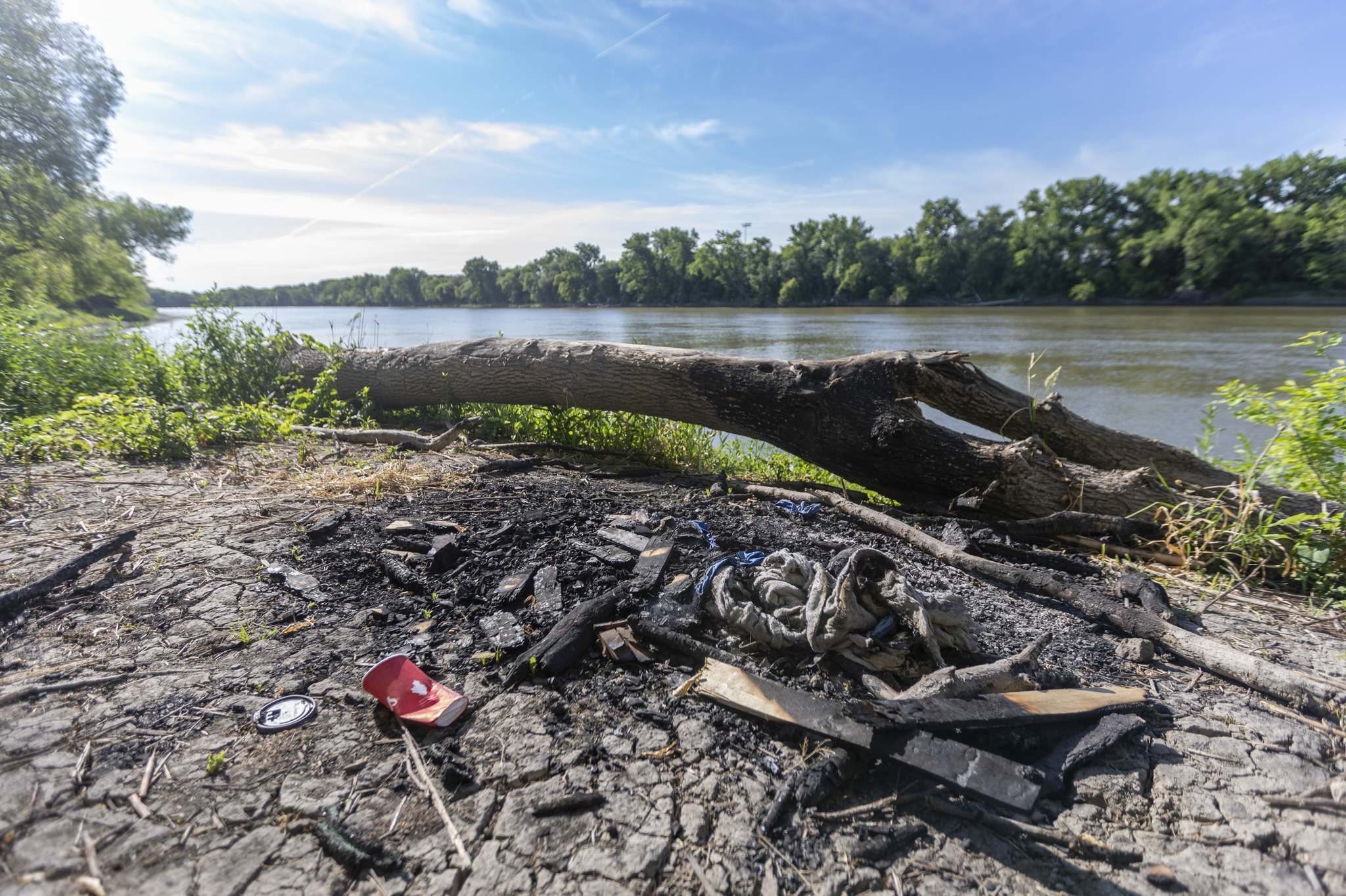 SASHA SEFTER / WINNIPEG FREE PRESS</p><p>A recently used fire pit on the bank of the Red River in the North end of Fort Douglas Park.</p>