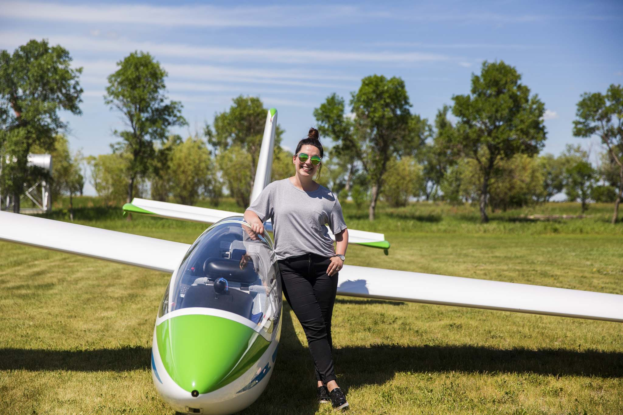MIKAELA MACKENZIE / WINNIPEG FREE PRESS</p><p>Columnist Jen Zoratti with the dual-control, two-seater PW-6 sailplane, an ideal glider for training.</p>