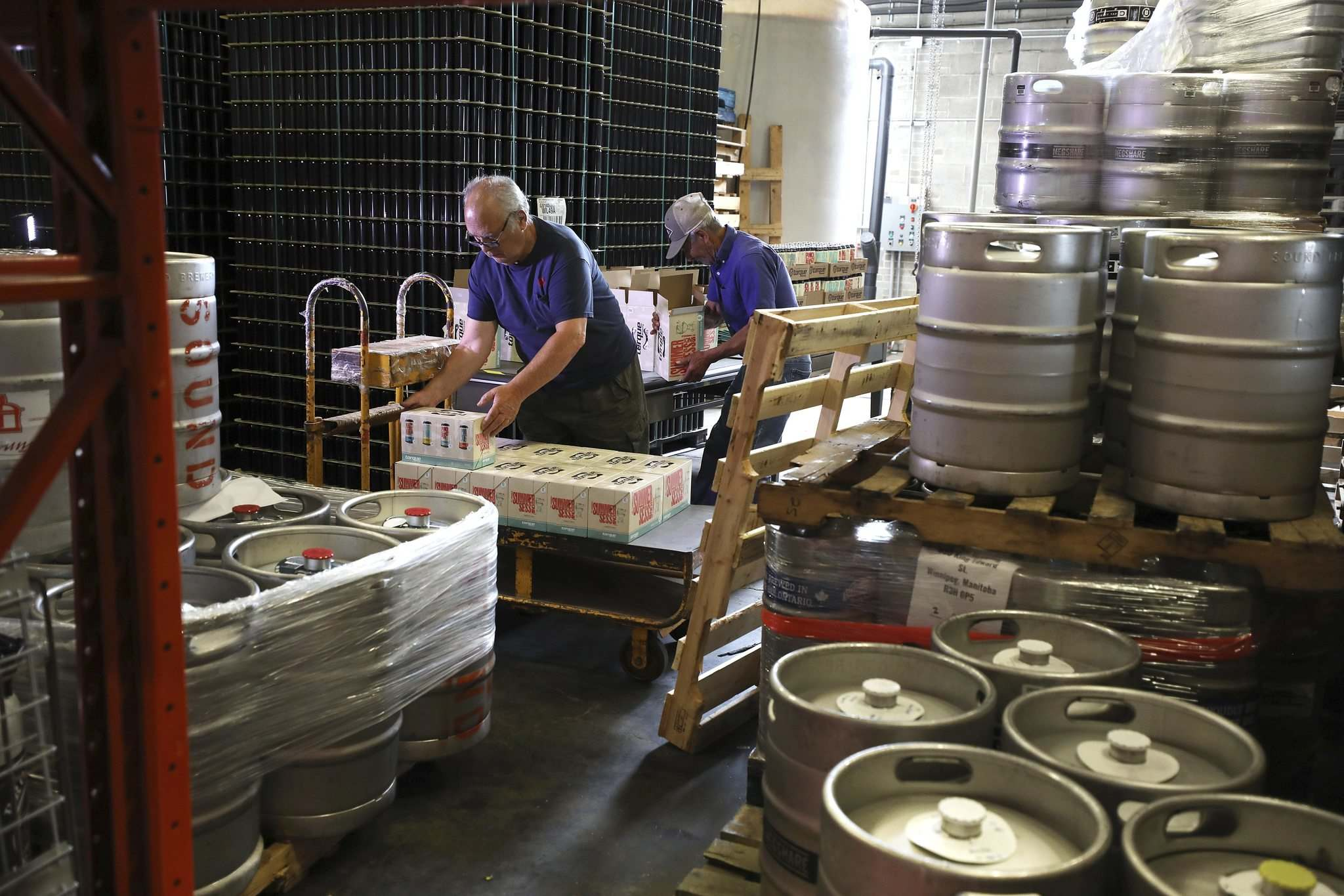 A shipment is prepared in Torque Brewing's distribution area. (Ruth Bonneville / Winnipeg Free Press)