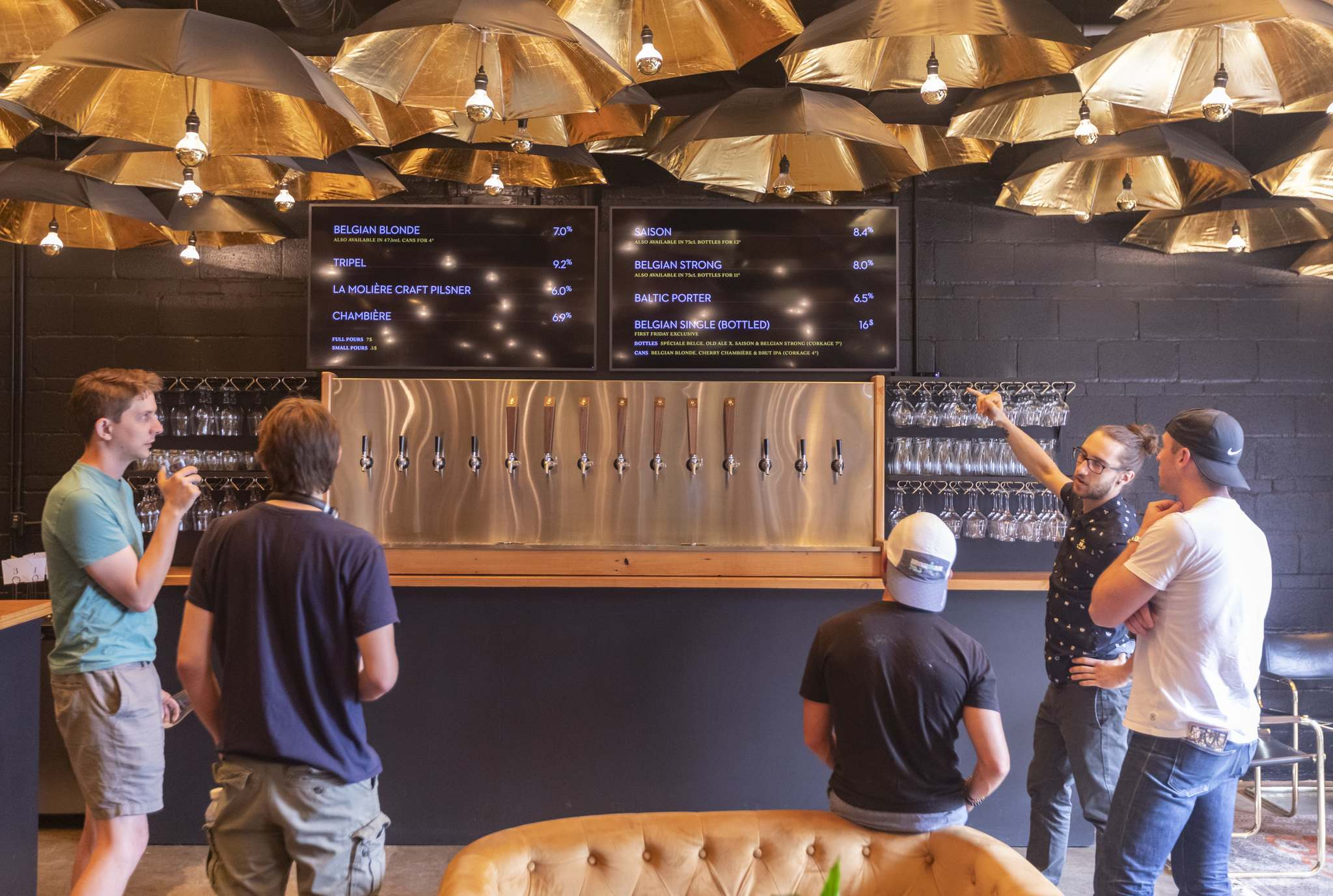 Bartender Dylan Picton explains the beer offerings to patrons in the taproom. (Sasha Sefter / Winnipeg Free Press)