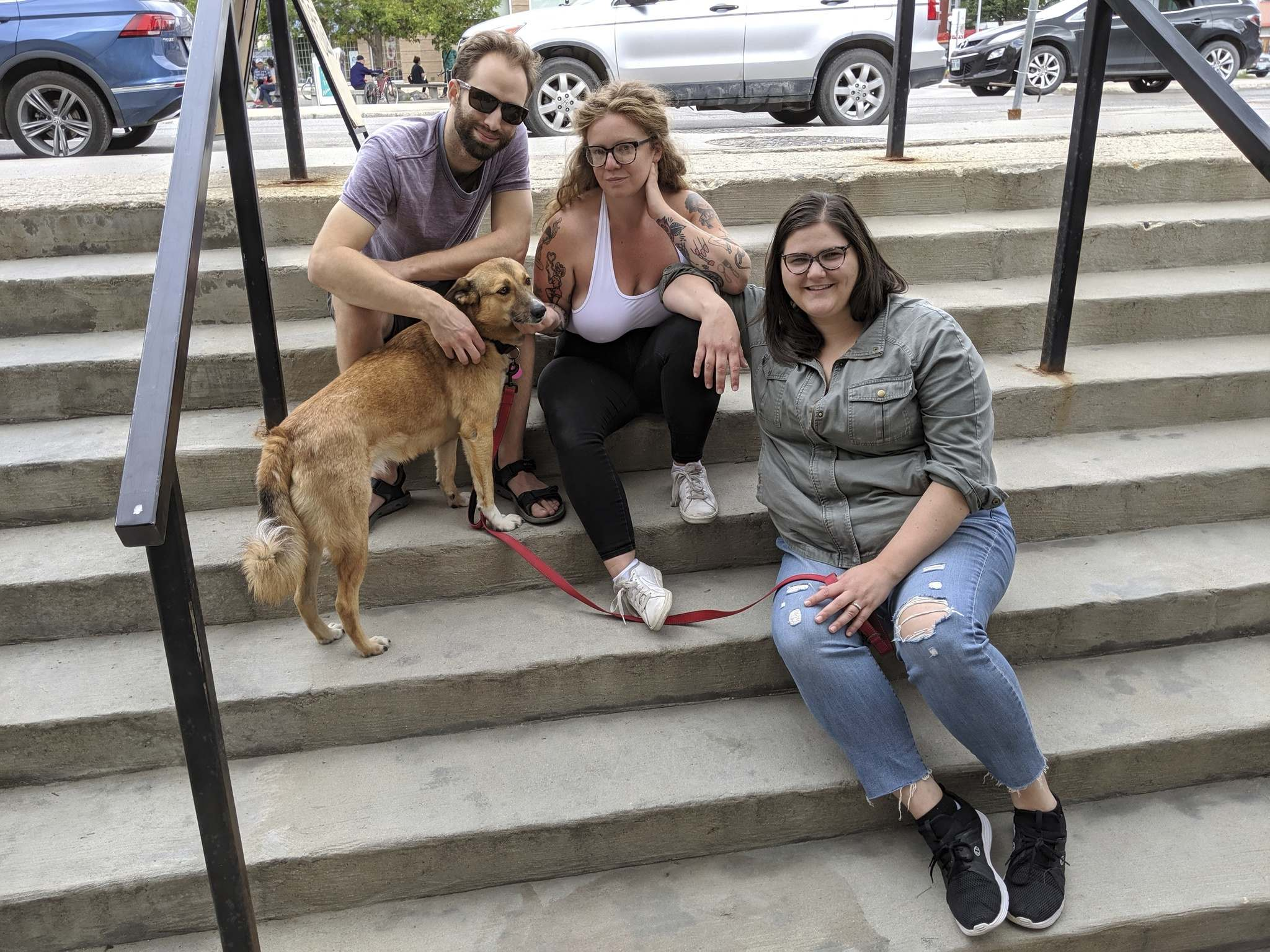 Cole Snyder (from left), Lauren Wilton and Elizabeth Shearer co-own their dog, Joni Mitchell.  (Supplied photo)