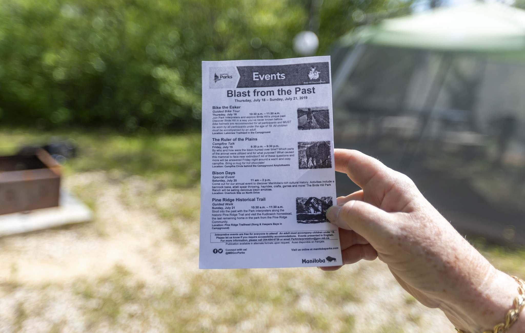 SASHA SEFTER / WINNIPEG FREE PRESS</p><p>Brenda Mattern holds up a flyer for upcoming events at Birds Hill Park. Handing these out to campers is one of her duties.</p>