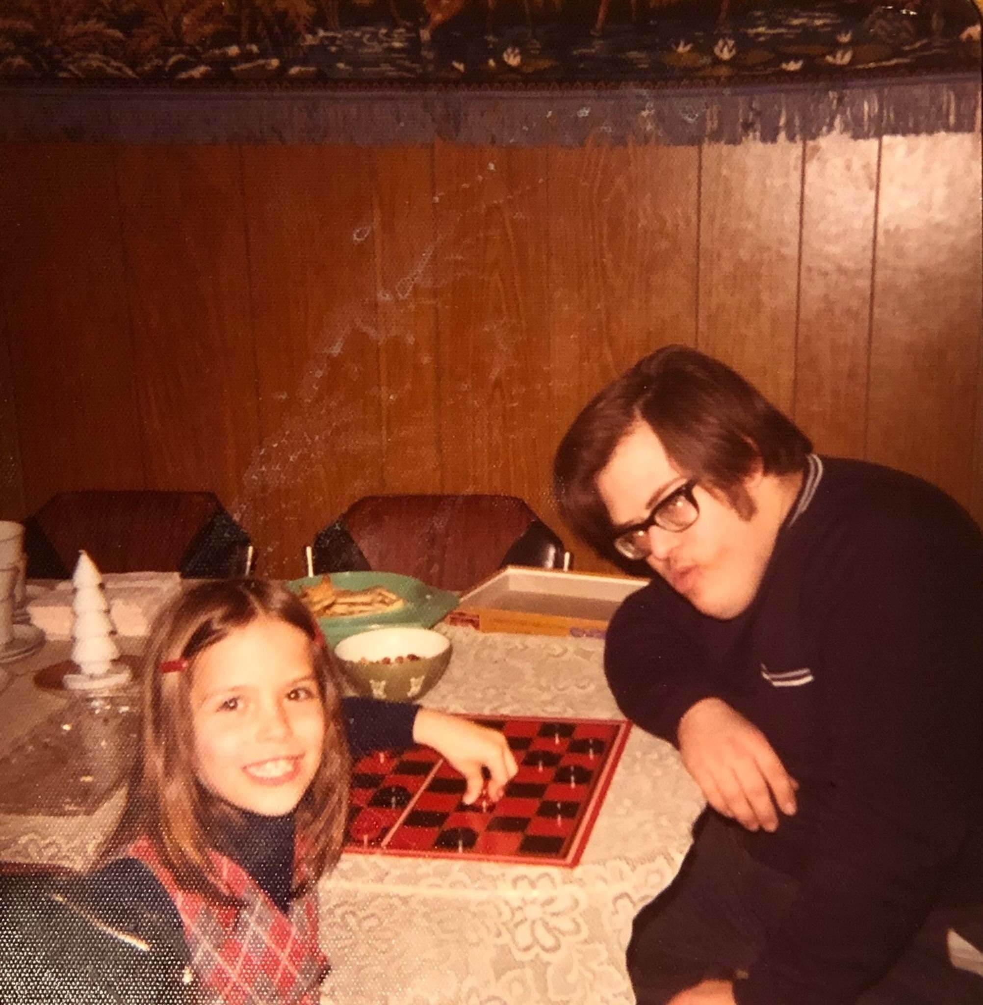 Bob plays checkers with his niece Laurie Bailey in the mid-1970s.</p>