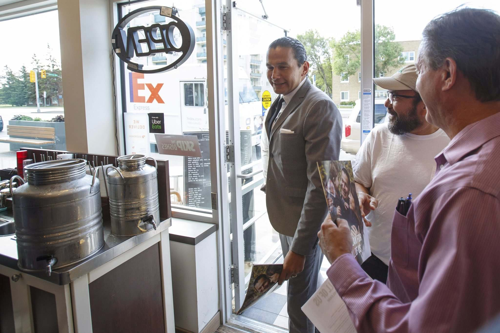 MIKE DEAL / WINNIPEG FREE PRESS</p><p>NDP Leader Wab Kinew arrives at the Yafa Café on Portage Avenue Thursday morning to release the party's platform for the upcoming provincial election.</p>