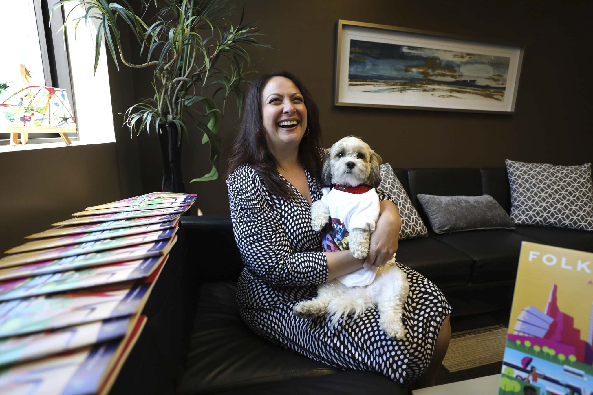 """""""Seeing all of what's taking place, this is a place where we celebrate culture and we can do that in safety and pride,"""" says Cotroneo, with office dog Wells. (Ruth Bonneville / Winnipeg Free Press)"""