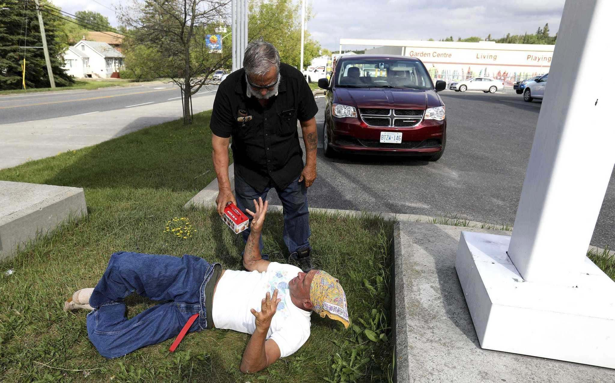 ERIC SEALS / DETROIT FREE PRESS / TNS</p><p>Joe Murphy often returns to sleep underneath the Canadian Tire gas station sign.